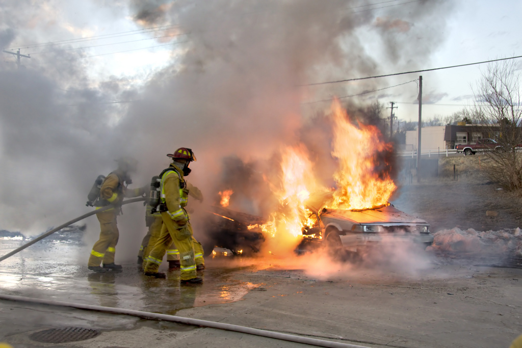 Firefighters extinguish a car fire. Photo via Andrew Magill.