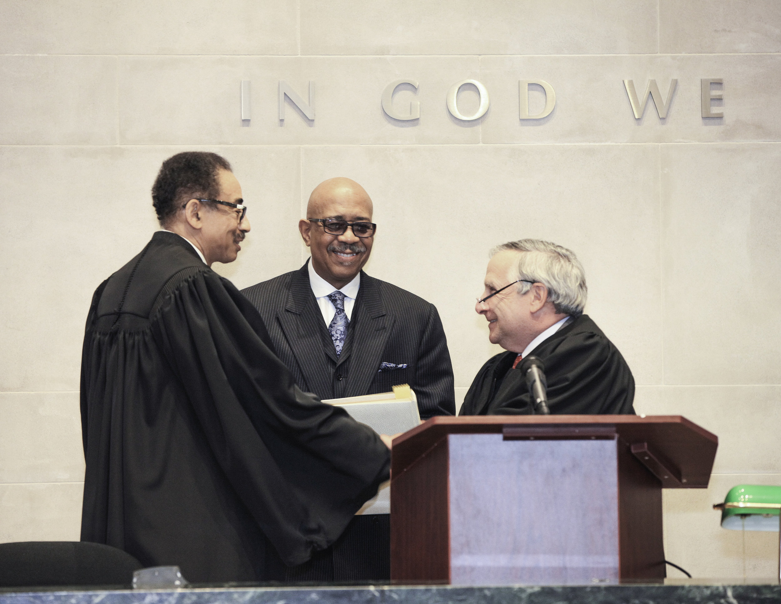 Newly elected Civil Court Judge Lance Evans (left) was sworn into office by Judge Jeremy Weinstein (right). Evans' cousin Joseph Evans (center) held the Bible. Photo by Pavan Carter of Pavan Carter Photography.