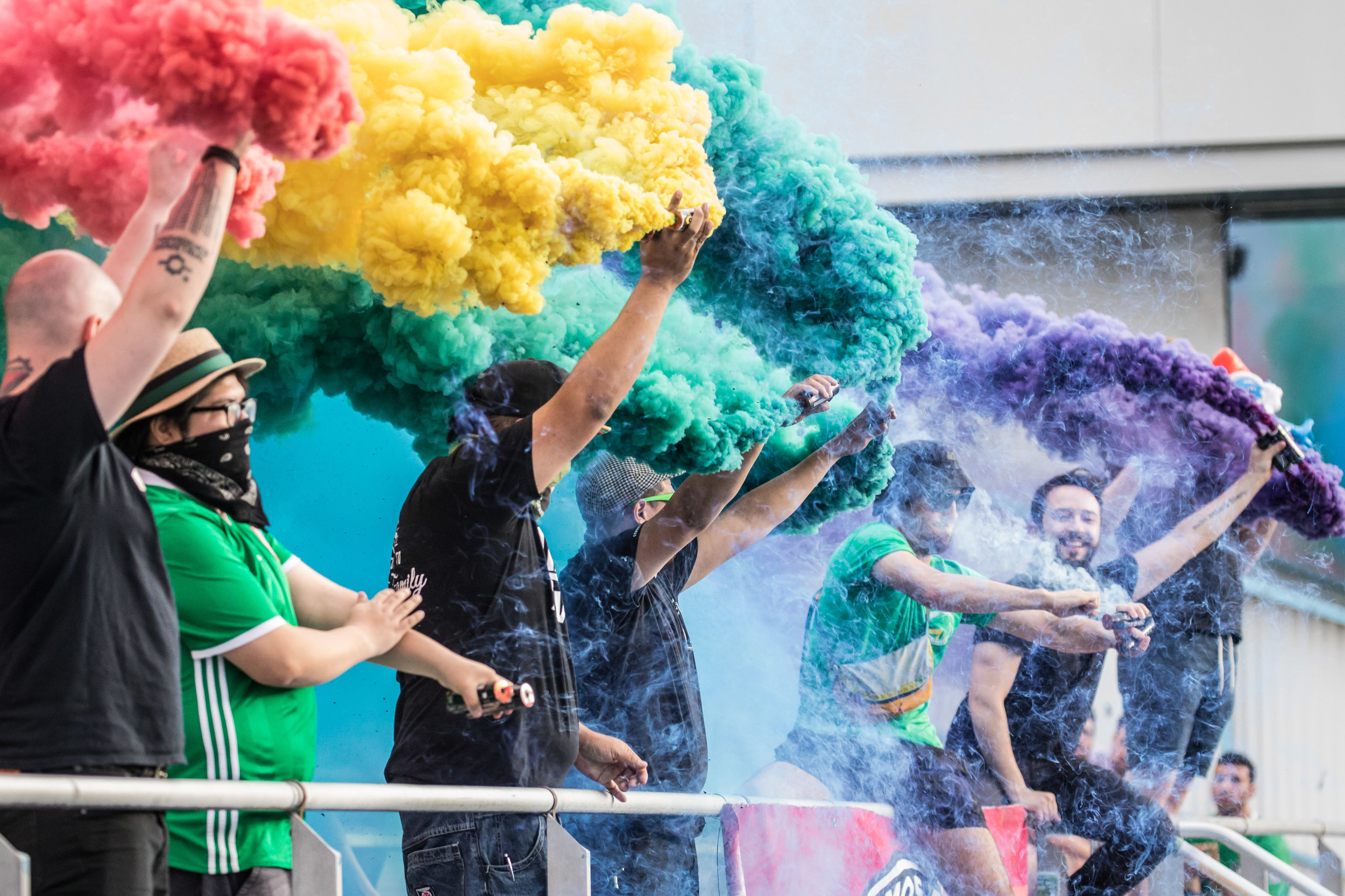 Cosmos fans celebrate in colorful fashion. // Photo by Matthew Levine
