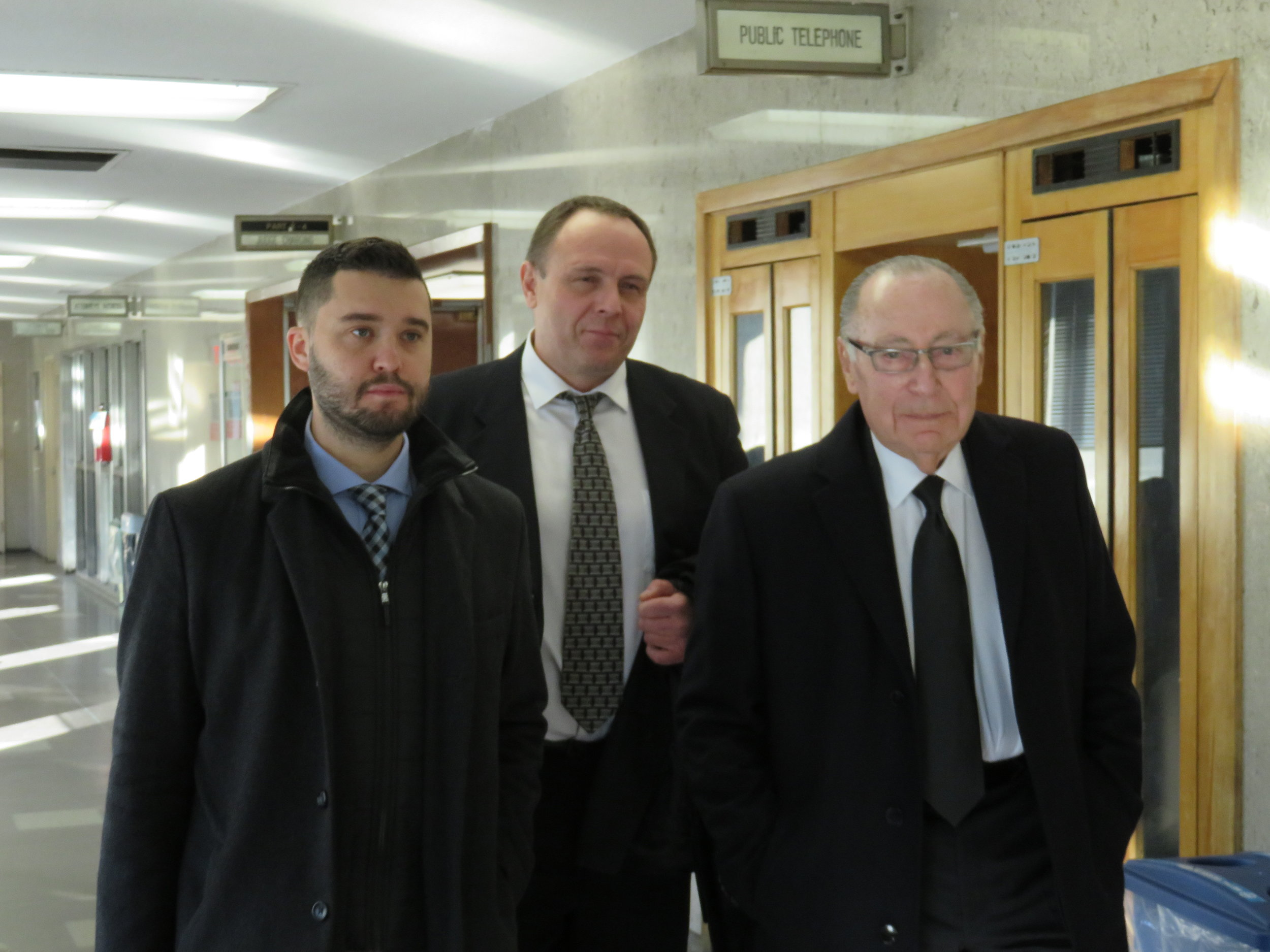 Yuriy Kruk (center) walks through the courthouse with defense attorneys Marvyn Kornberg (right) and Dmitriy Shakhnevich (left) after Justice Richard Buchter acquitted him at a bench trial.  Eagle  photo by David Brand.