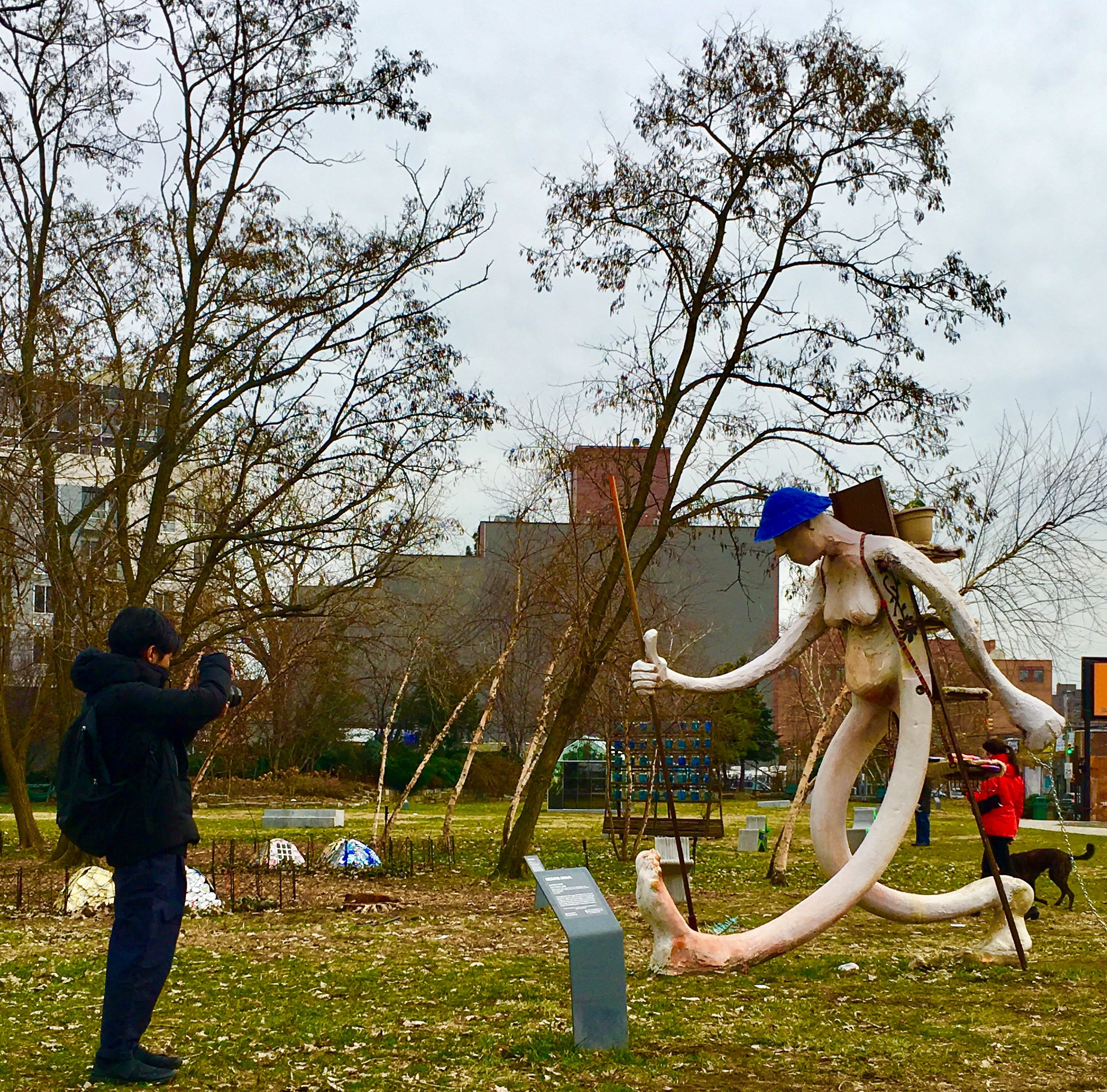 "Socrates Sculpture Park visitors get a close look at ""Free Peddler"" by Brooklyn-based artist Antone Konst."