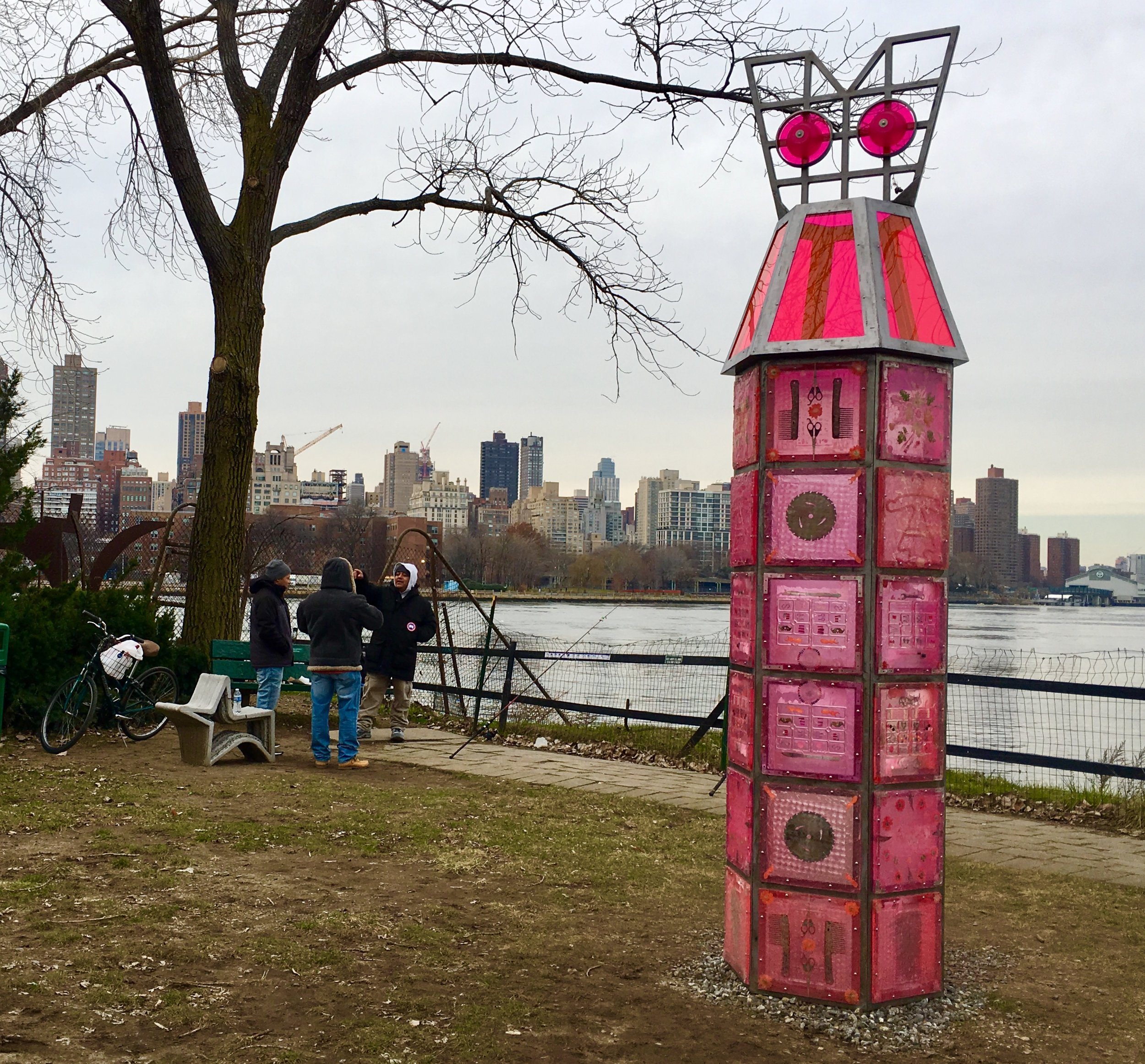 "Folks are fishing beside ""Fort-Dress,"" a sculpture by Amy Brener at Socrates Sculpture Park."