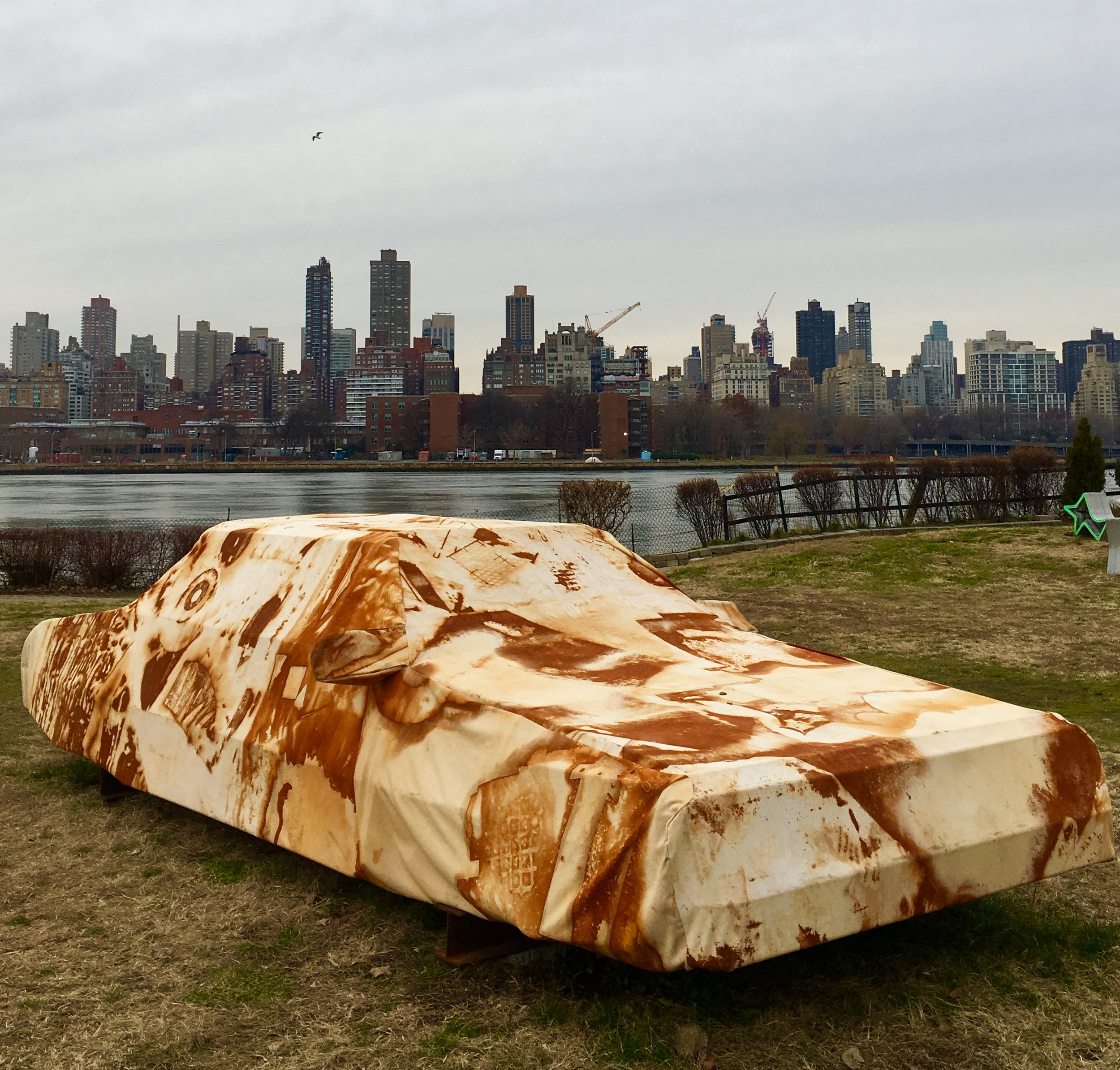 "Park on Long Island City's waterfront. ""Into the ground,"" the eye-catching sculpture in the foreground, is by artists Joe Riley and Audrey Snyder."