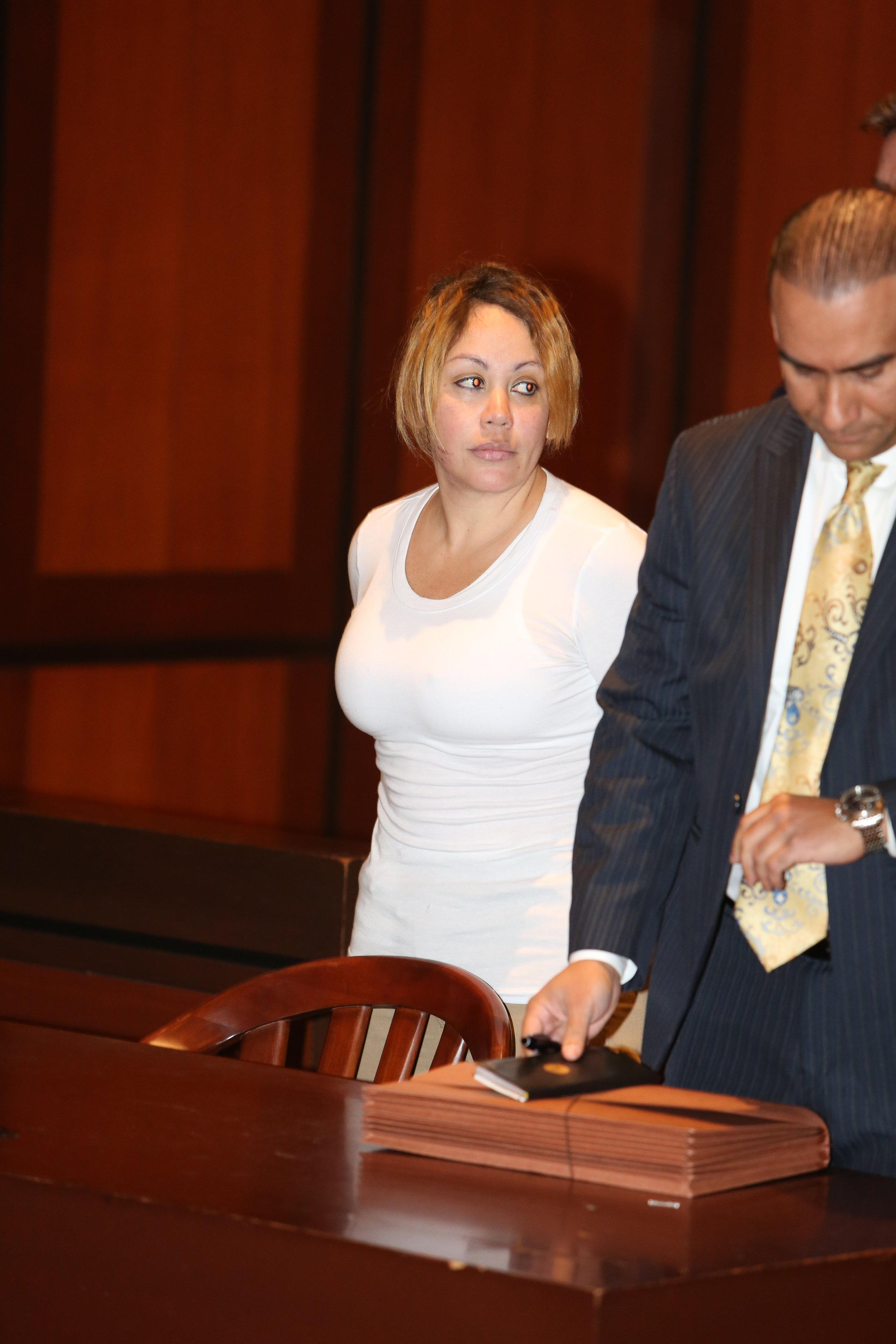 Arelis Peralta is accused of running the organization with her husband, Ludwig Paz. Pool photo by Ellis Kaplan