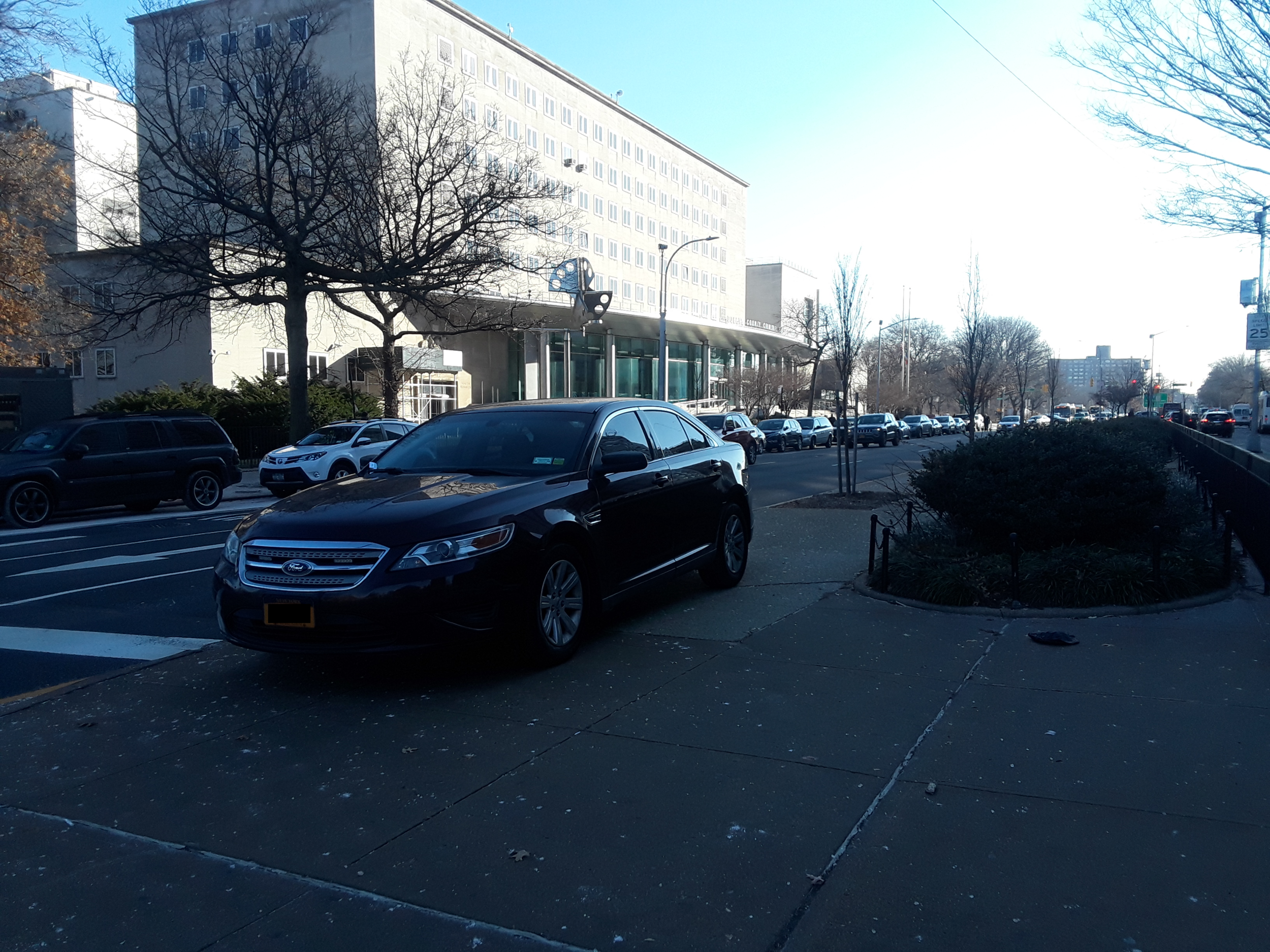Burgundy car parked on the median of Queens Boulevard on Dec. 11 without a ticket. The anonymous reporter with NYP plates received a ticket for parking on the same median.