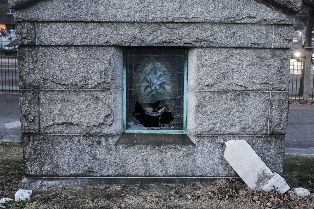 The shattered window of a mausoleum at All Faiths Cemetery in Middle Village.