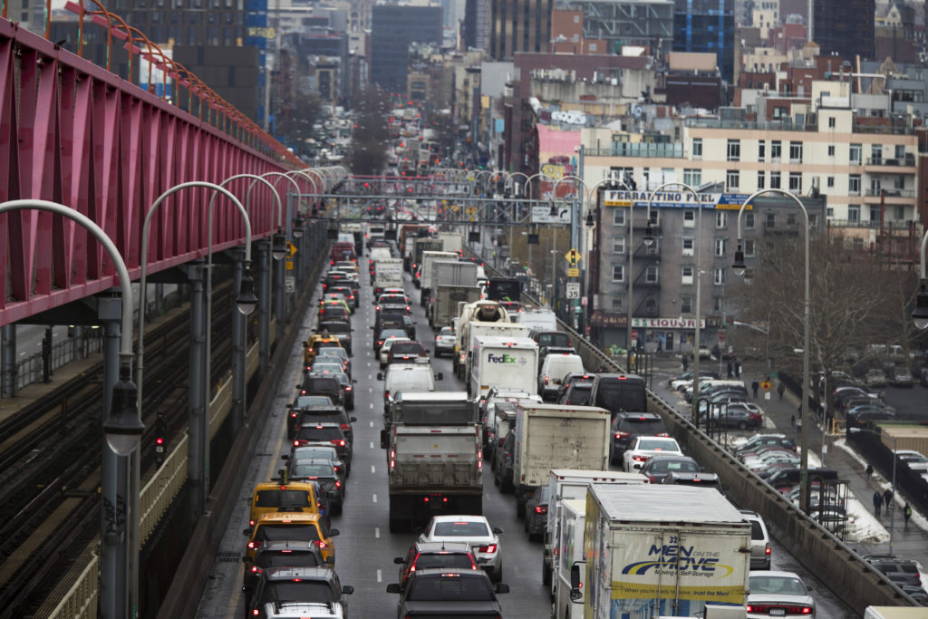 In this Jan. 11 photo, traffic crosses the Williamsburg Bridge in New York from Brooklyn into Manhattan. AP Photo/Mary Altaffer, File.