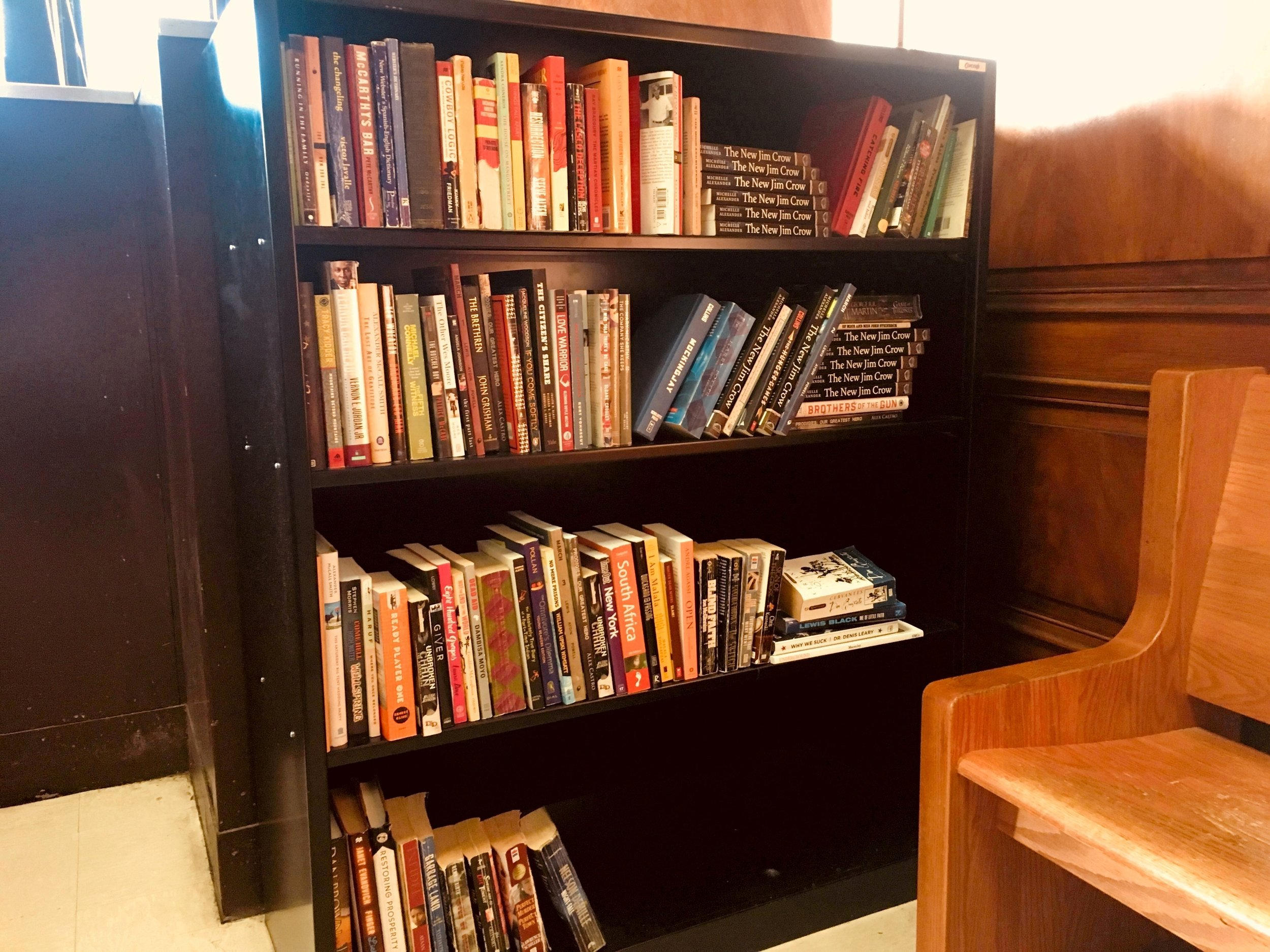 A new shelf of books at Brooklyn Adolescent and Young Adult Diversion Court. Legal Aid said it plans to introduce book in Queens as well. Photo courtesy of Legal Aids.