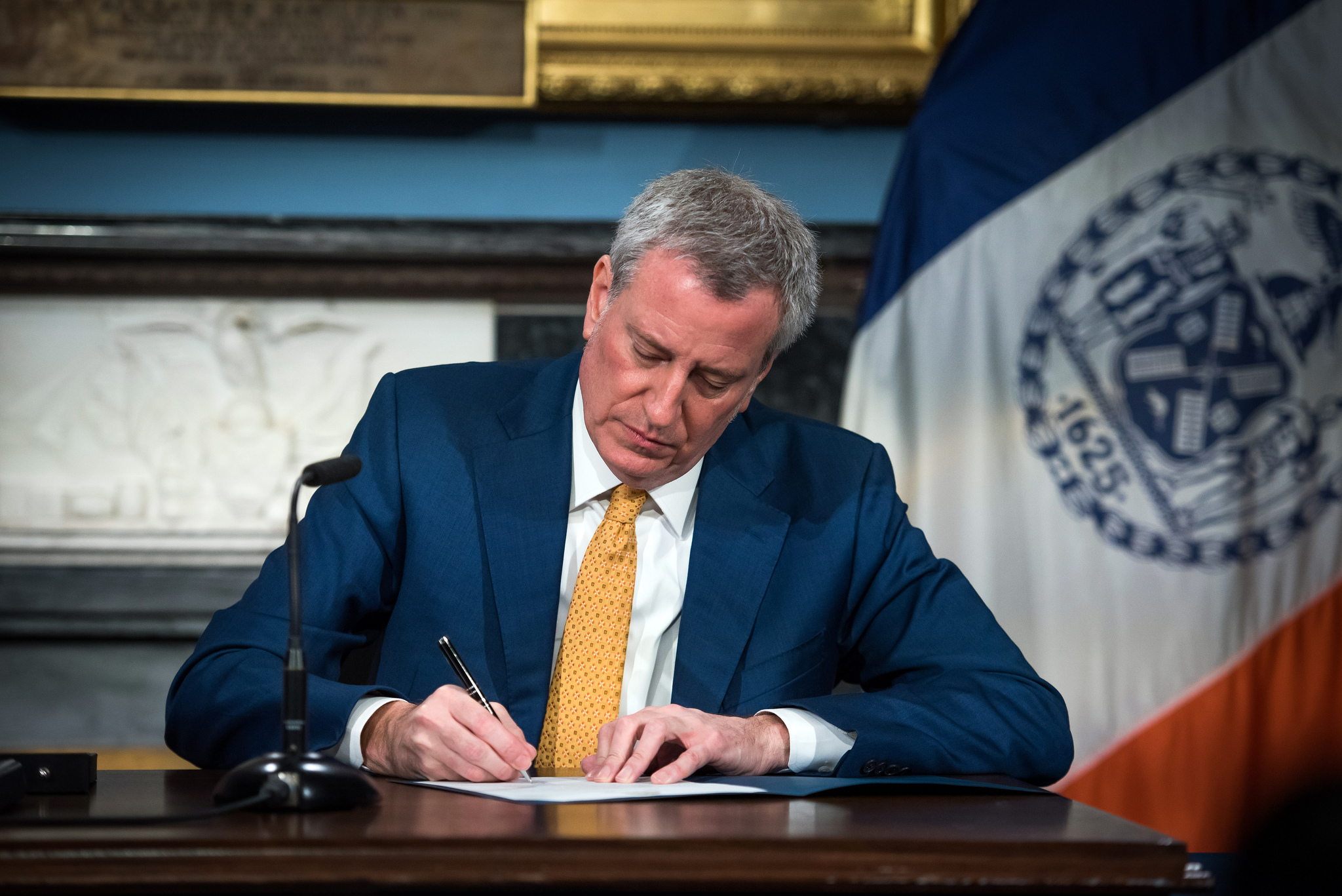 Mayor Bill de Blasio signs a campaign finance bill at City Hall on Jan. 2. At the same ceremony, he signed a proclamation declaring Feb. 26 as the date for the special election for public advocate. Photo via Flickr/NYCMayorsOffice