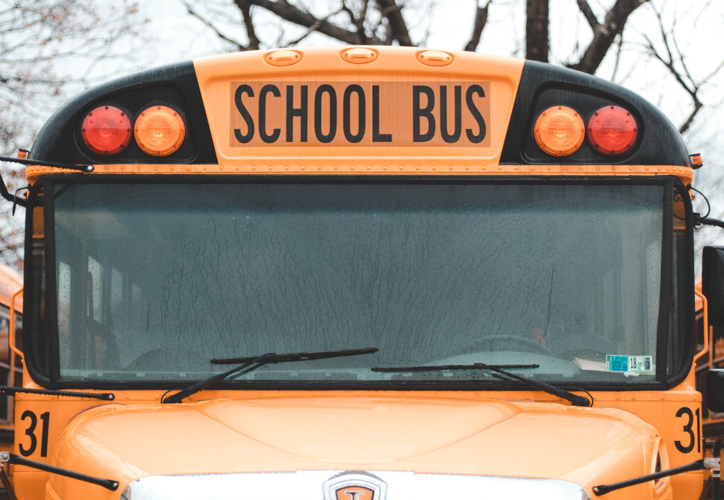 The City Council approved legislation to install GPS trackers on all school buses. Photo by Austin Pacheco/Unsplash