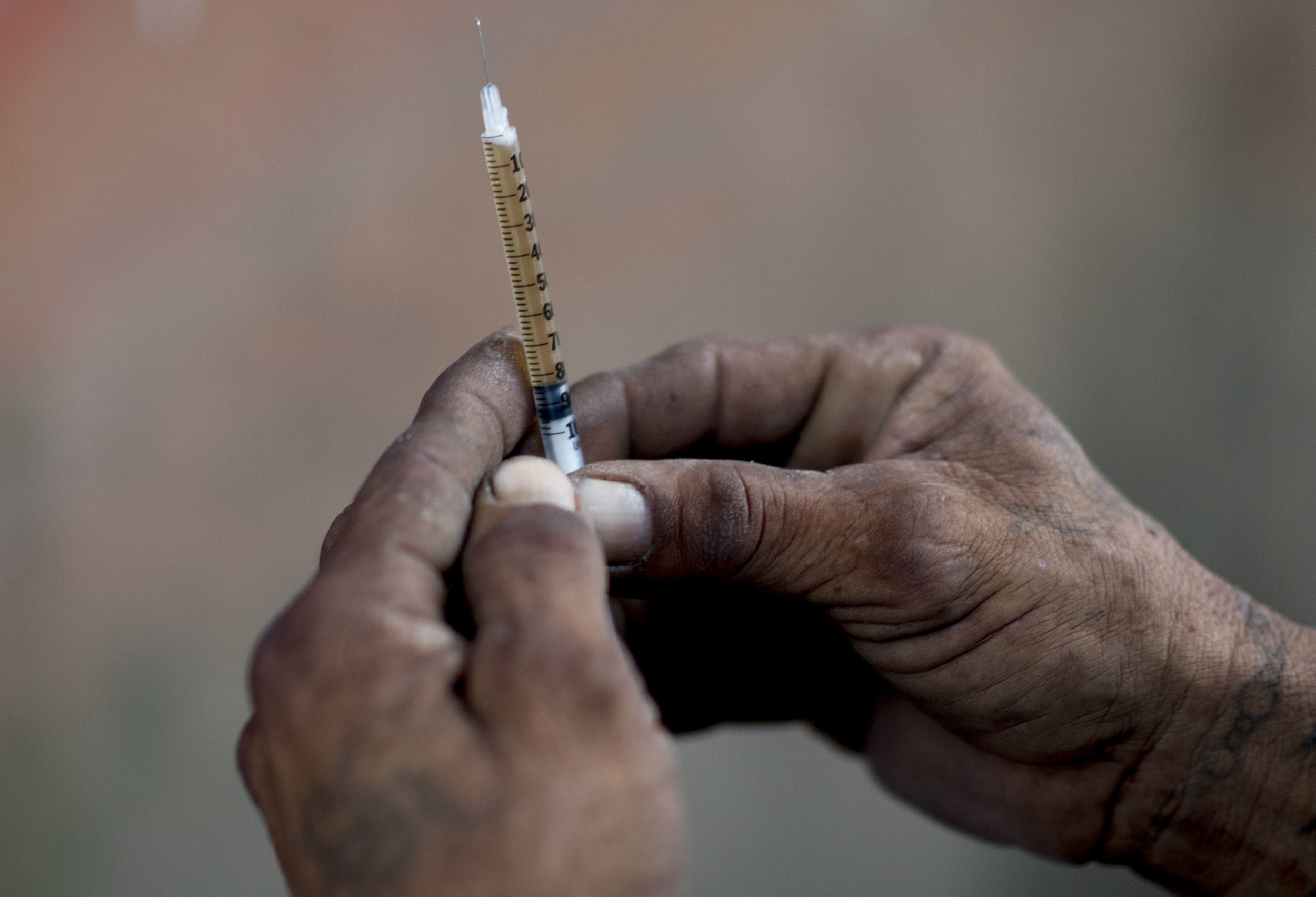 Heroin inside of a needle. (AP Photo/Carlos Giusti)