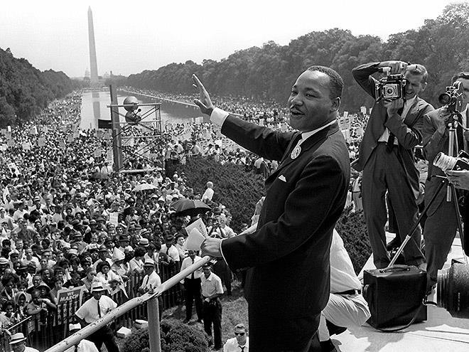 "Dr. Martin Luther King Jr. after delivering his ""I Have a Dream"" speech on the steps of the Lincoln Memorial in Washington D.C. Photo via the National Park Service."
