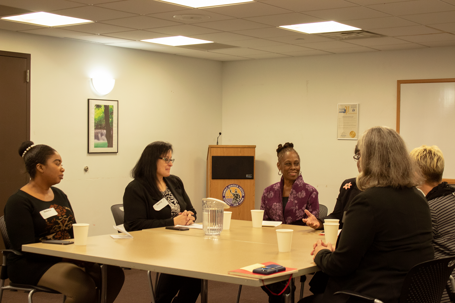 New York City First Lady Chirlane McCray sat down with leaders of the Family Justice Center mental health program and domestic violence survivors on Thursday to honor the anniversary of the program in Queens.  Eagle  photo by Victoria Merlino