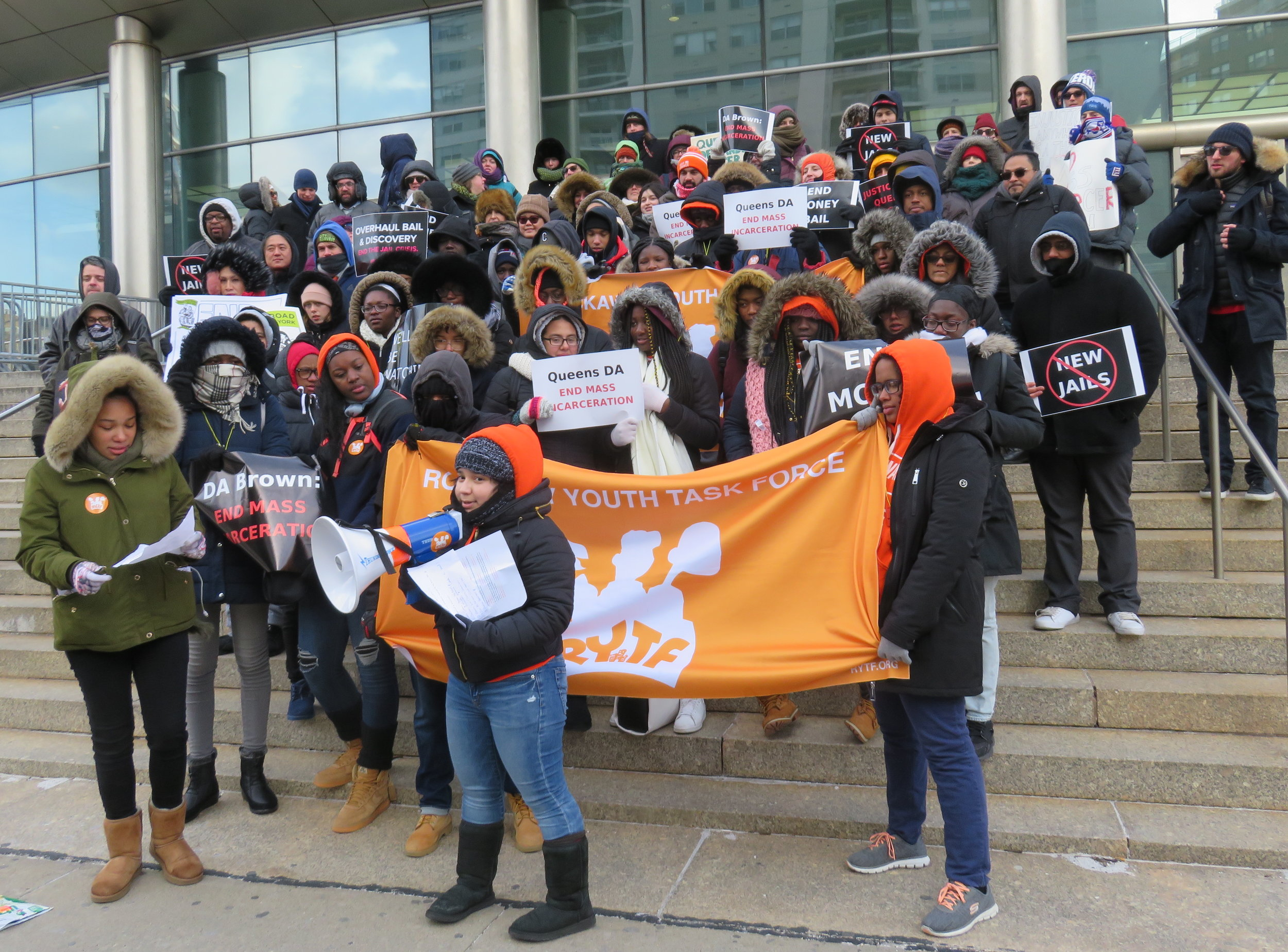 The Queens for DA Accountability coalition demonstrates on the steps of the Queens Criminal Courthouse Monday. Eagle photo by David Brand