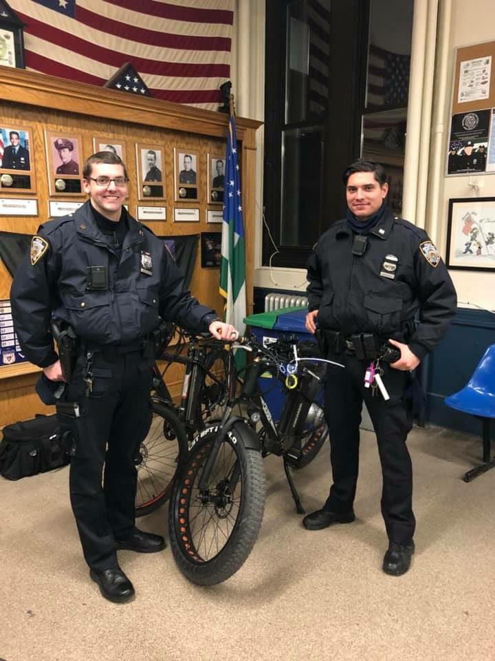 Officers from the 10th Precinct in Manhattan stand with seized e-bikes. Twitter  photo  via 10th Precinct