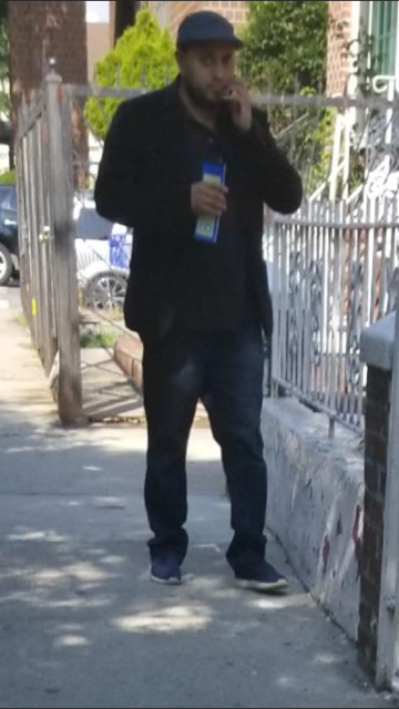 The suspect in a rash of real estate scams in Corona, Elmhurst and Flushing. Photo courtesy of the NYPD.