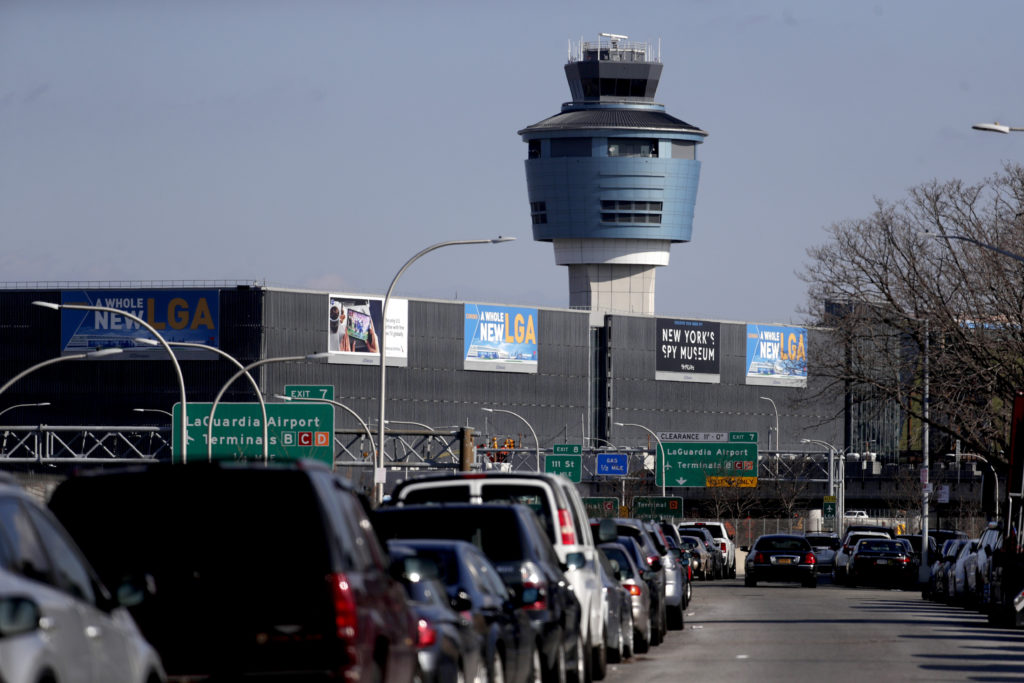 """The air traffic control tower at LaGuardia Airport is pictured here on Friday. The Federal Aviation Administration reported delays in air travel Friday because of a """"slight increase in sick leave"""" at two East Coast air traffic control facilities. AP Photo/Julio Cortez."""