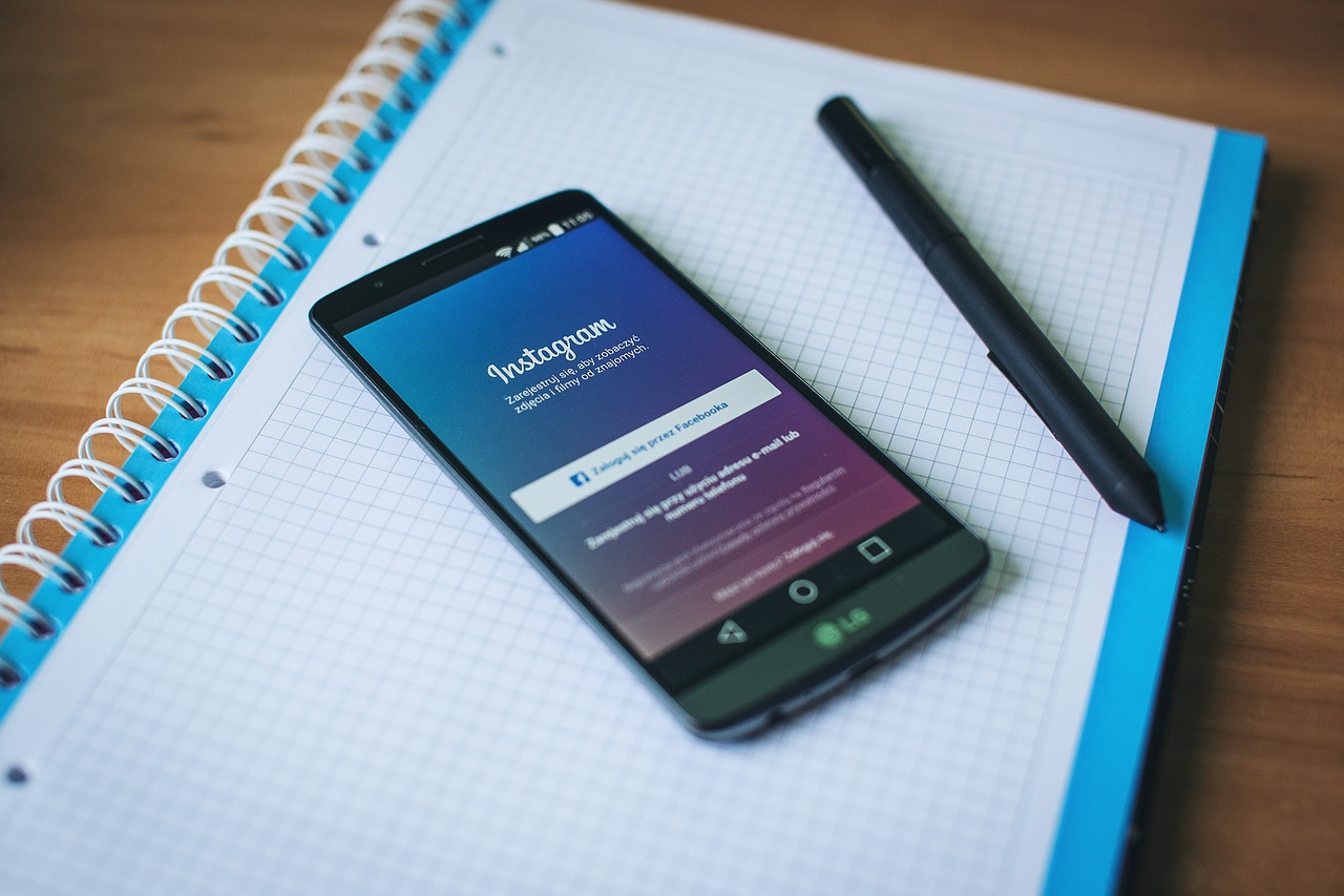 The Instagram app open on a phone. Photo via Pixabay.