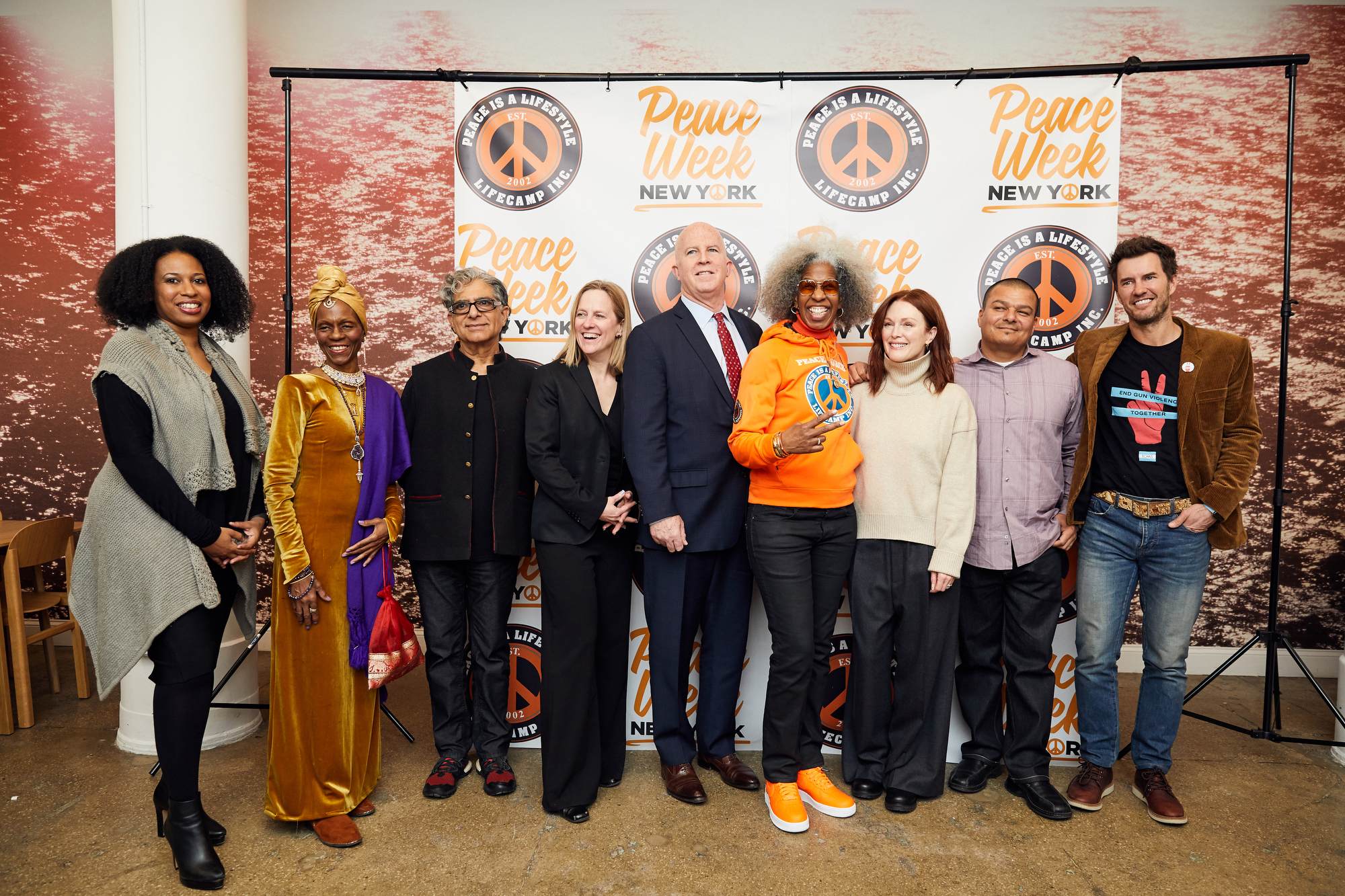 From left, Dr. Aletha Maybank, deputy commissioner of the New York City Department of Health and Mental Hygiene; wellness practitioner Queen Afua; best-selling author Deepak Chopra, Borough President Melinda Katz; NYPD Commissioner James O'Neill; Erica Ford of LIFE Camp, Inc; Academy Award-winning actress Julianne Moore; Hector Verdugo, the associate executive director at HomeBoy Industries and co-chair of the National Black & Brown Gun Violence Prevention Consortium; and Blake Mycoskie, CEO of TOMS Shoes. Photo courtesy of Borough Hall.