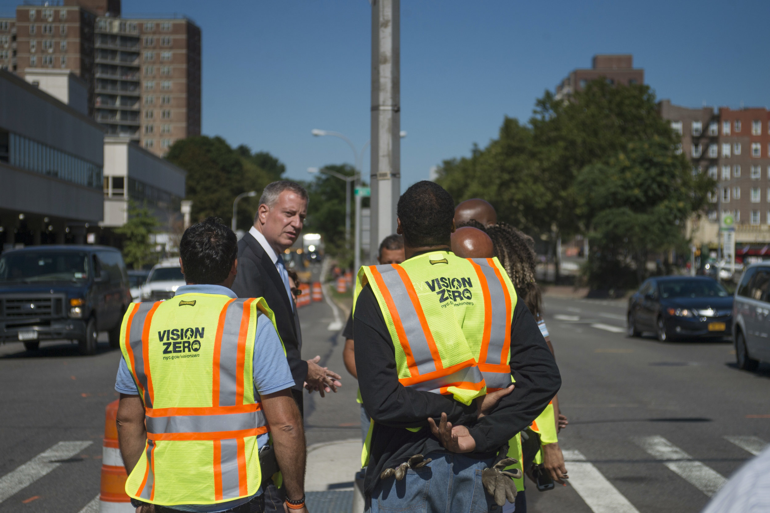 Mayor Bill de Blasio stands at 61st Street and Queens Boulevard after announcing the start of a $100 million Vision Zero project to redesign Queens Boulevard. So far this year, pedestrian deaths and injuries have increased in Queens. Ed Reed/Mayoral Photography Office.