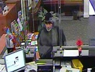 A Queens County Savings Bank was held up for cash on Monday. Cops are still searching for the suspect, seen here in a surveillance image. Photo courtesy of the NYPD