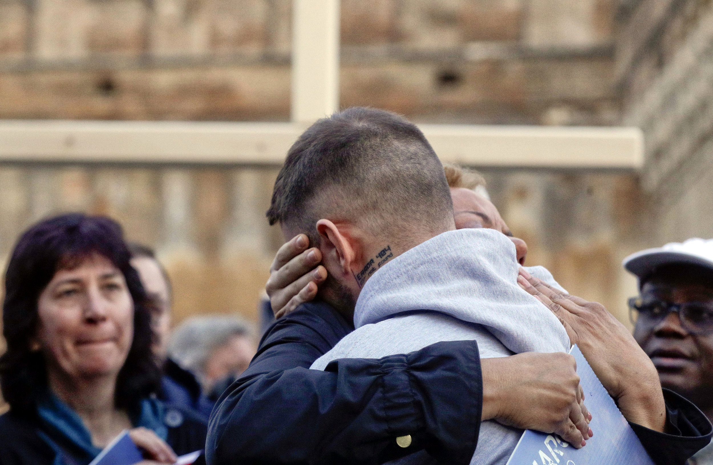 Survivors of clergy sex abuse hug during a twilight vigil prayer near Castle Sant' Angelo, in Rome on Thursday during a landmark sex abuse prevention summit. AP Photo/Gregorio Borgia.