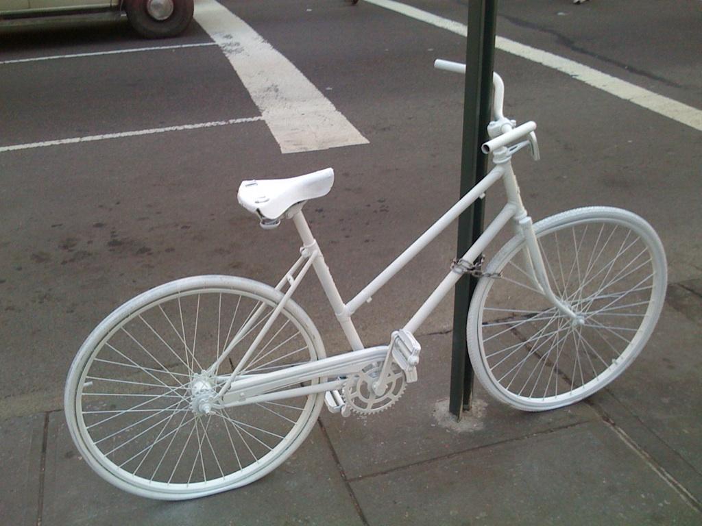 A ghost bike memorializes a cyclist killed in a car crash. Photo by Salim Virji/Flickr