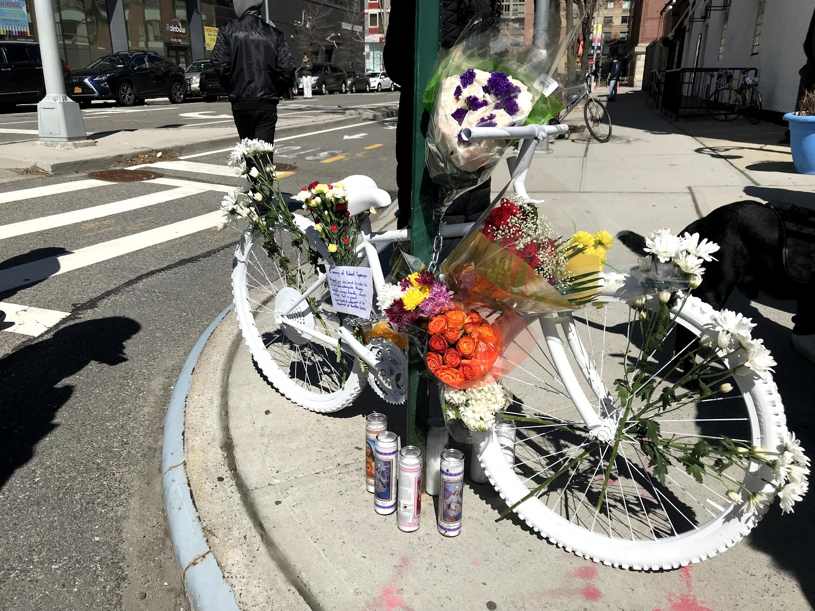 A ghost bike is stationed at the site of the crash that killed Robert Spencer in Long Island City.  Eagle  photos by Dave Colon.