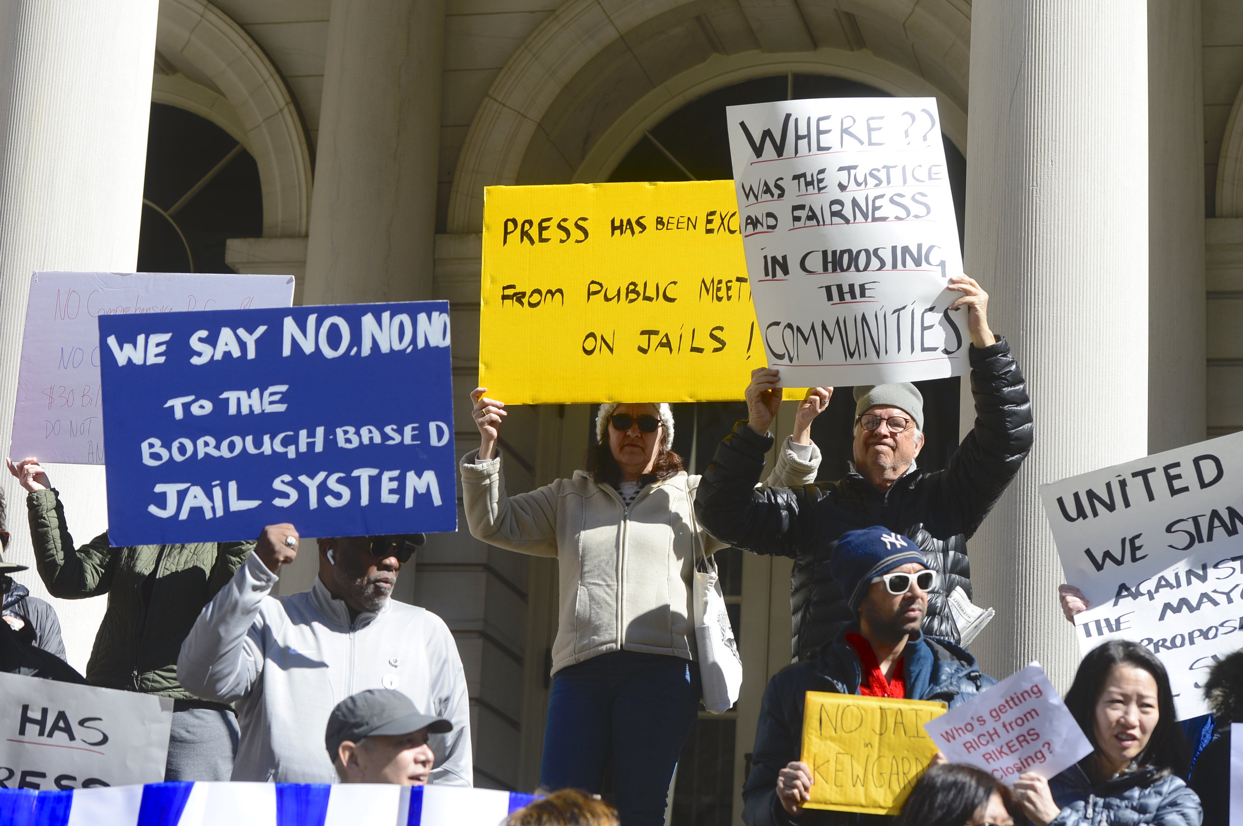 Demonstrators oppose the plan for a new jail in Kew Gardens at a City Hall rally on Sunday.  Eagle  photos by Todd Maisel.