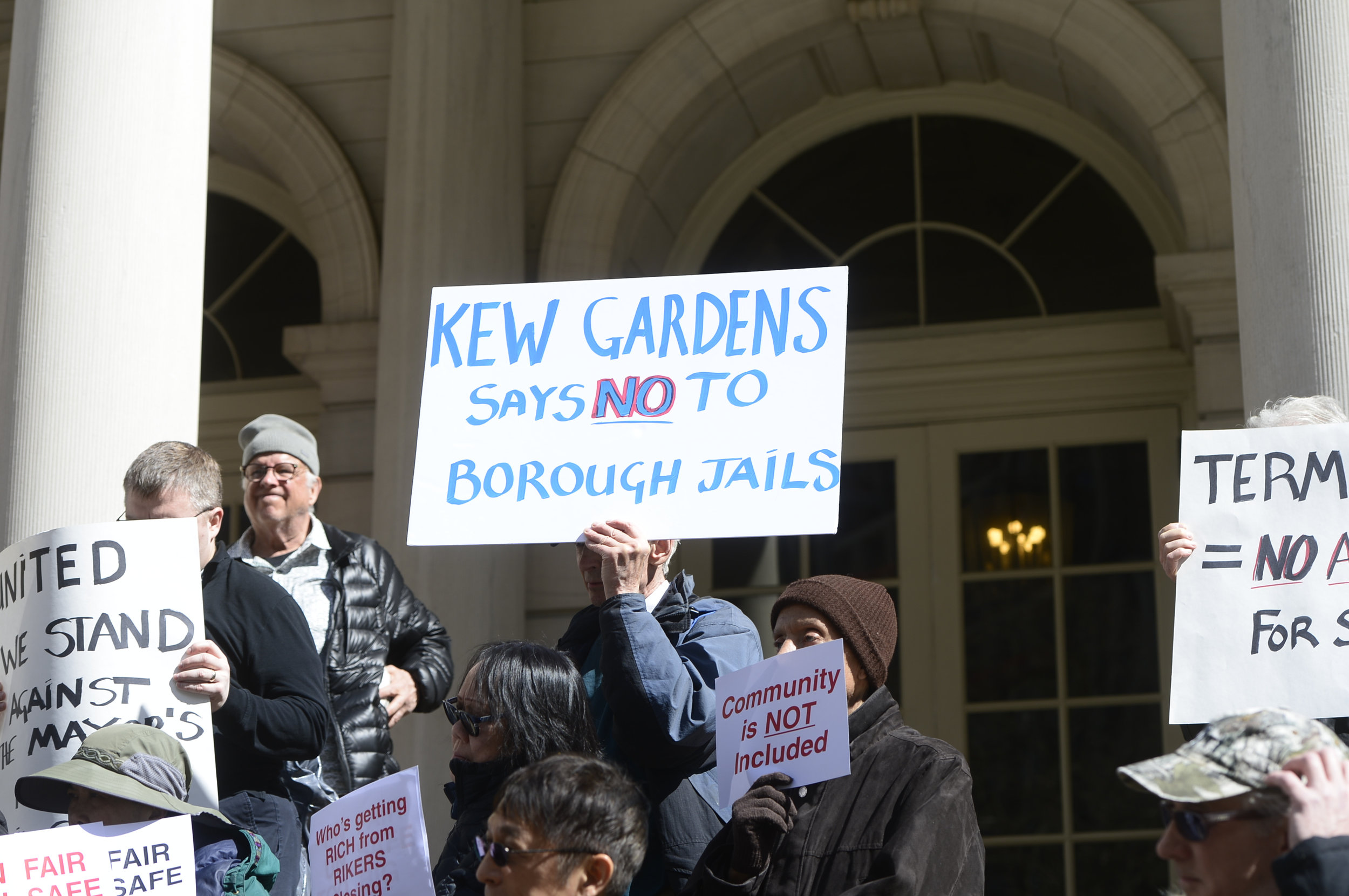 Demonstrators oppose the plan for a new jail in Kew Gardens at a City Hall rally on Sunday.
