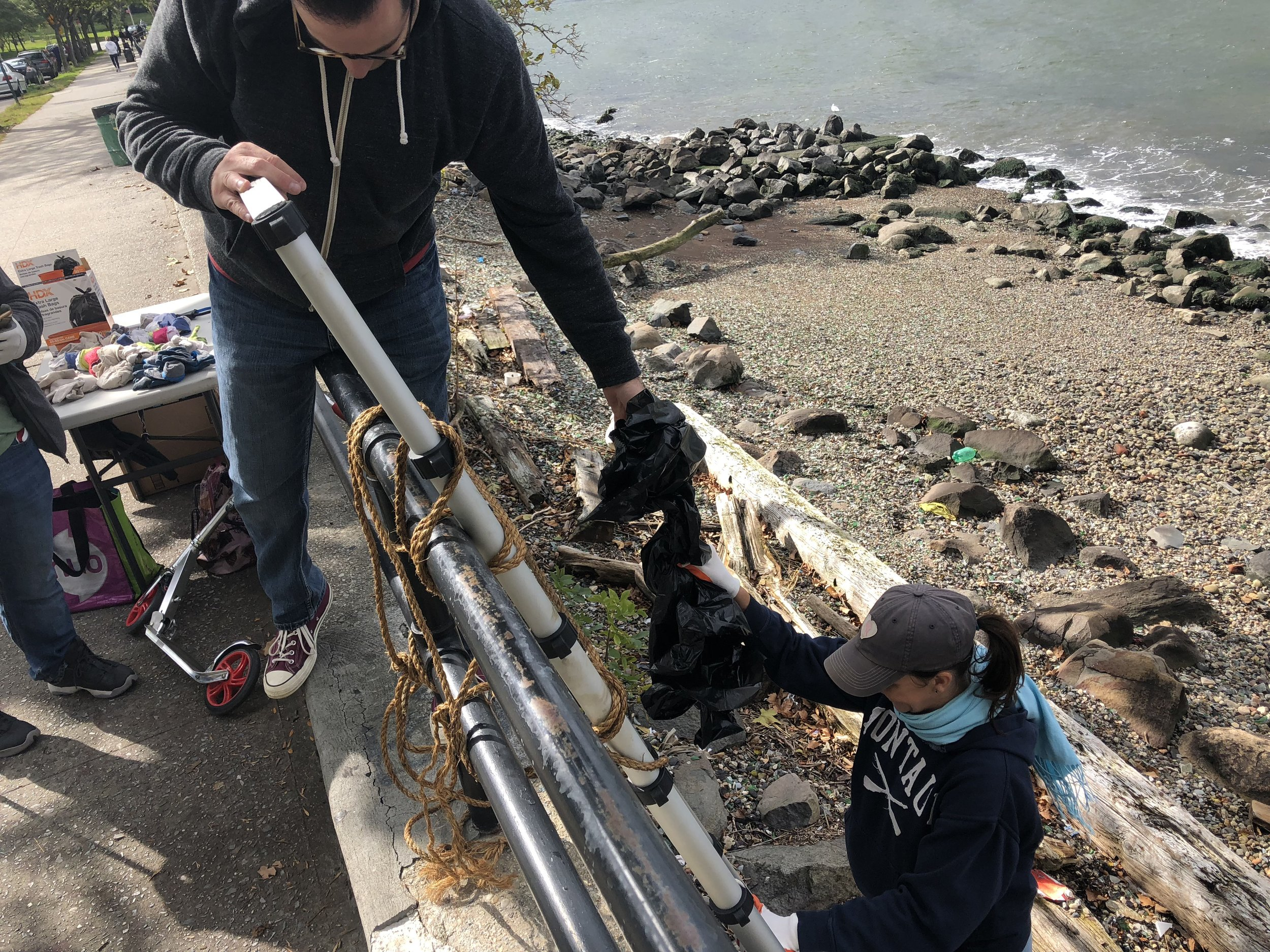Volunteers from the Astoria Park Alliance cleanup the park's shoreline.