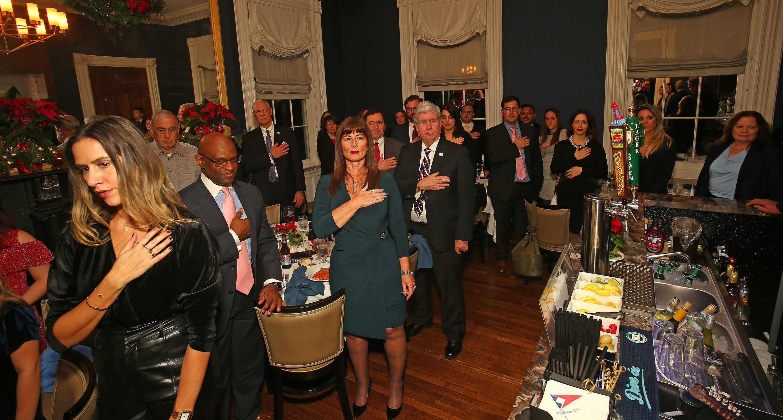 ADAs, judges and guests stand for the star spangled banner.