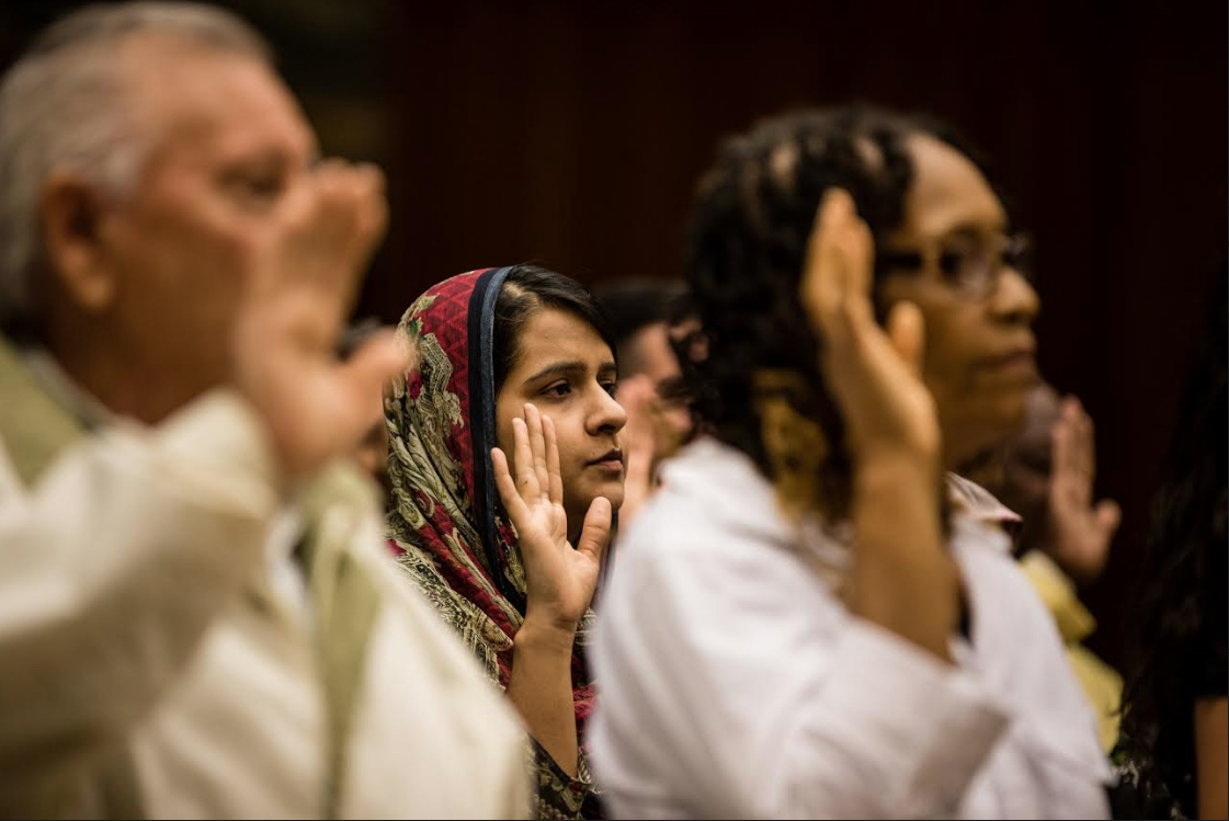 A new citizen takes the Oath of Allegiance at a special ceremony on Citizenship Day in Brooklyn Federal Court in September.  Eagle  file photos by Paul Frangipane.