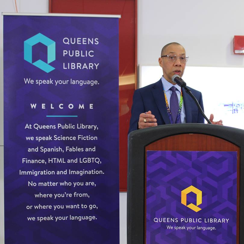 Queens Public Library President and CEO Dennis Walcott speaks earlier this month at an event unveiling QPL's new name, logo and credo. Photo via the Queens Public Library.