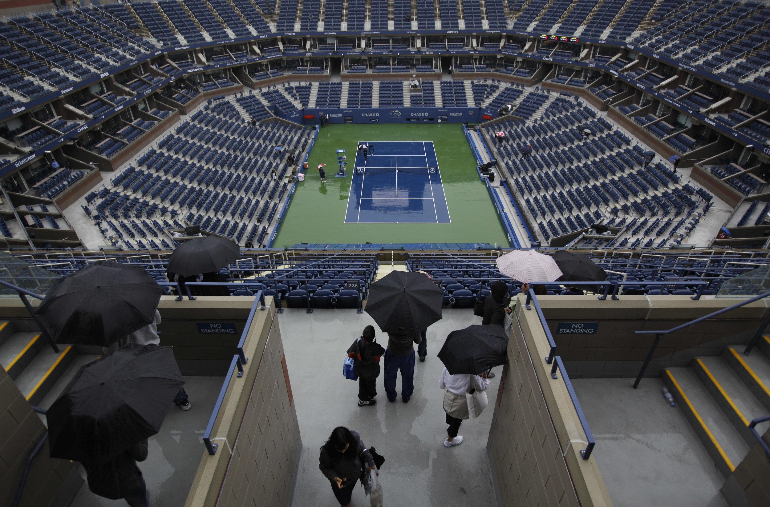 Fans arrive at Arthur Ashe Stadium during a U.S. Open tennis tournament. (AP Photo/Matt Slocum).