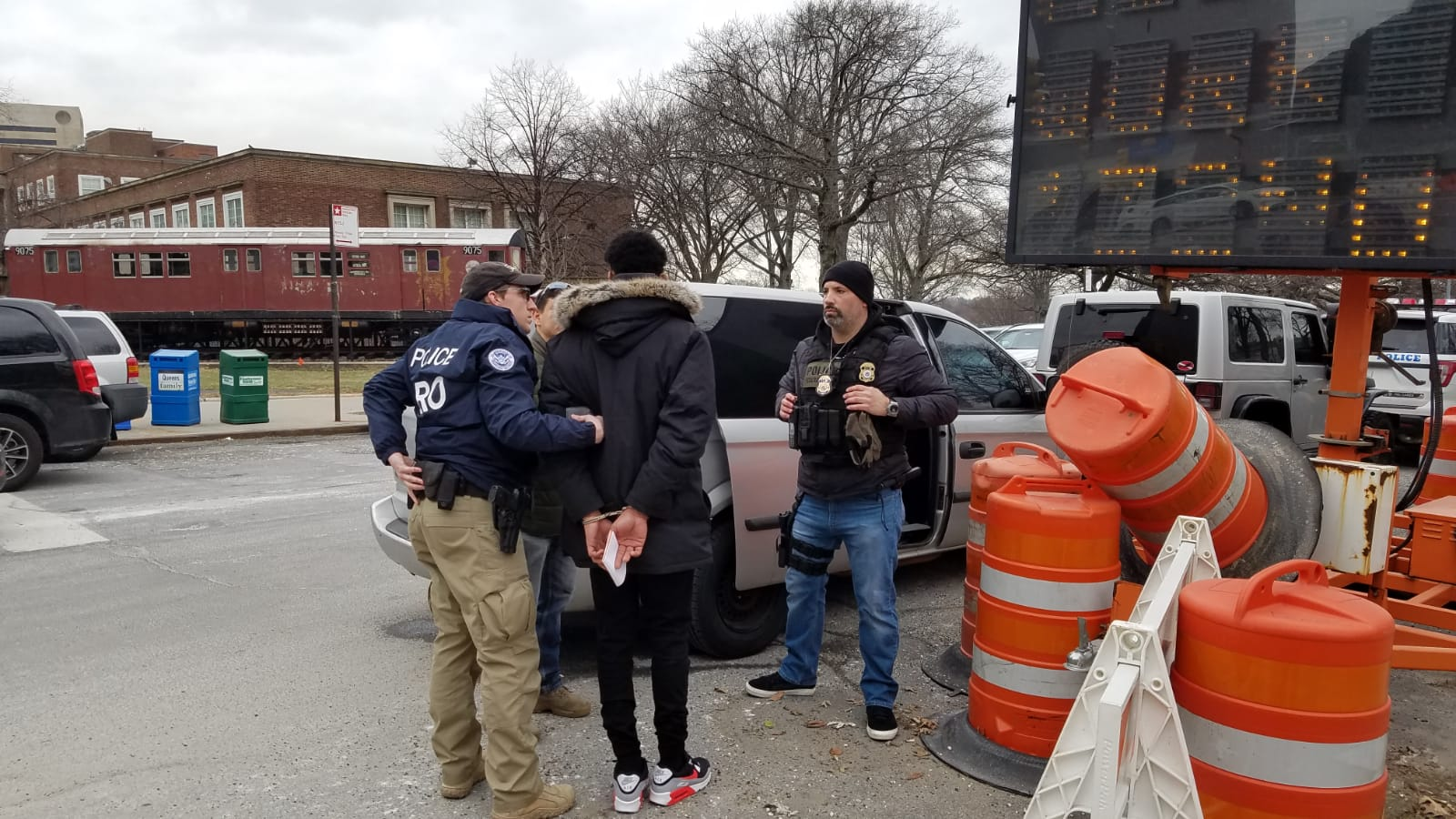 ICE officers arrest an immigrant outside the Queens Criminal Courthouse. Photo obtained by the  Eagle