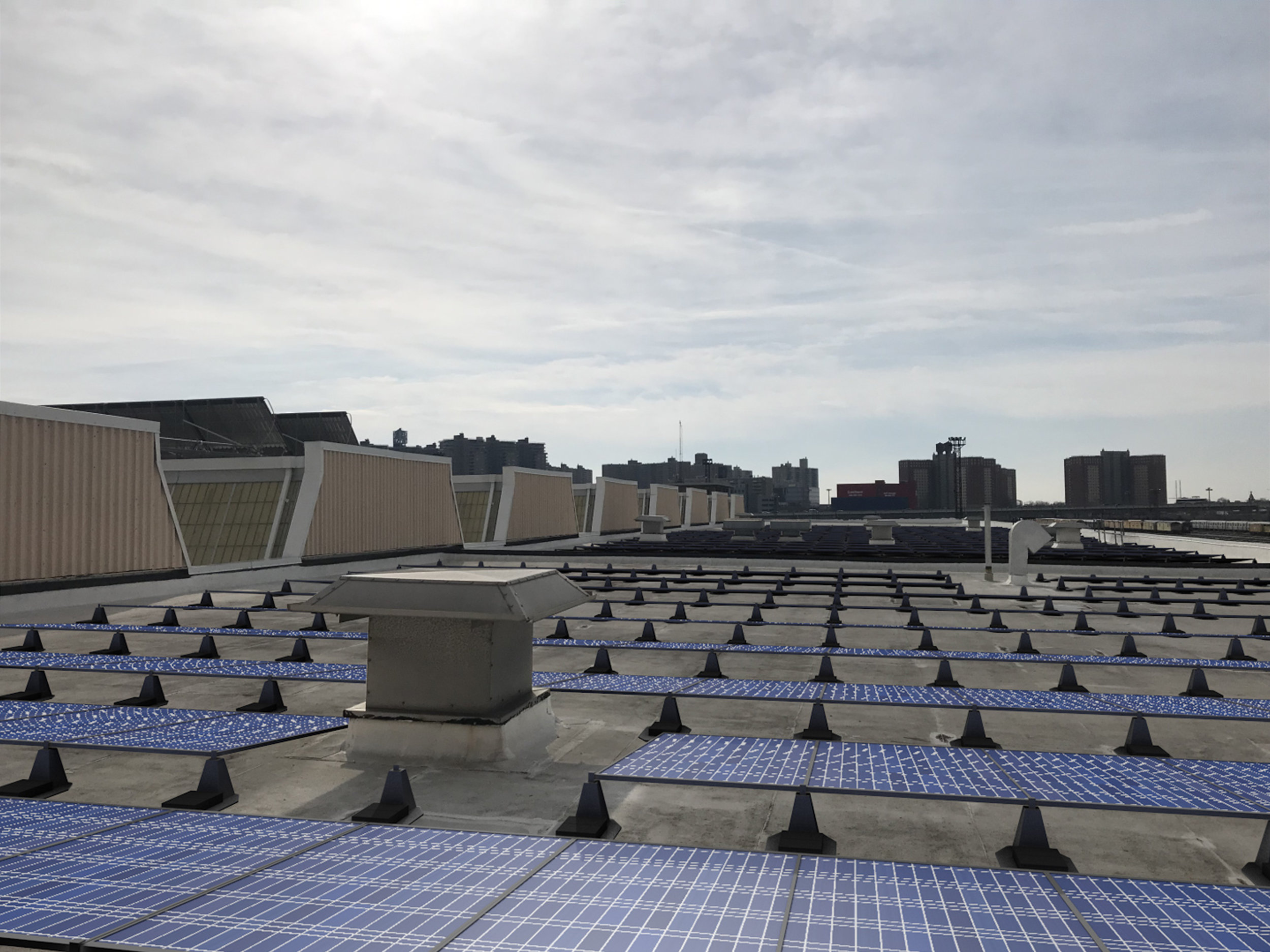The MTA would place solar panels on the roofs of certain MTA structures, such as the Coney Island Maintenance Facility, under a new proposal. Rendering courtesy of the MTA.
