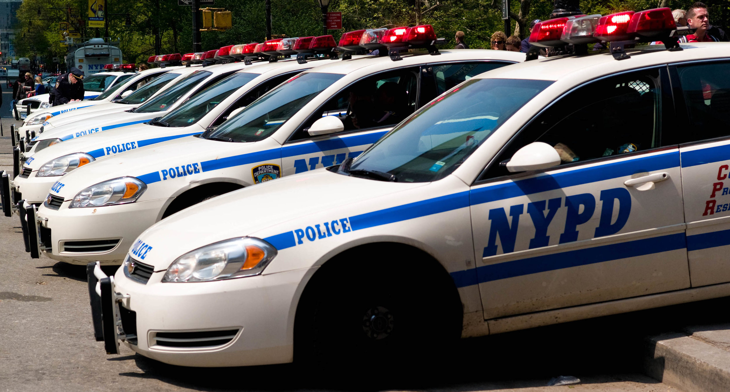 A line of NYPD squad cars. Photo by Joy Ito