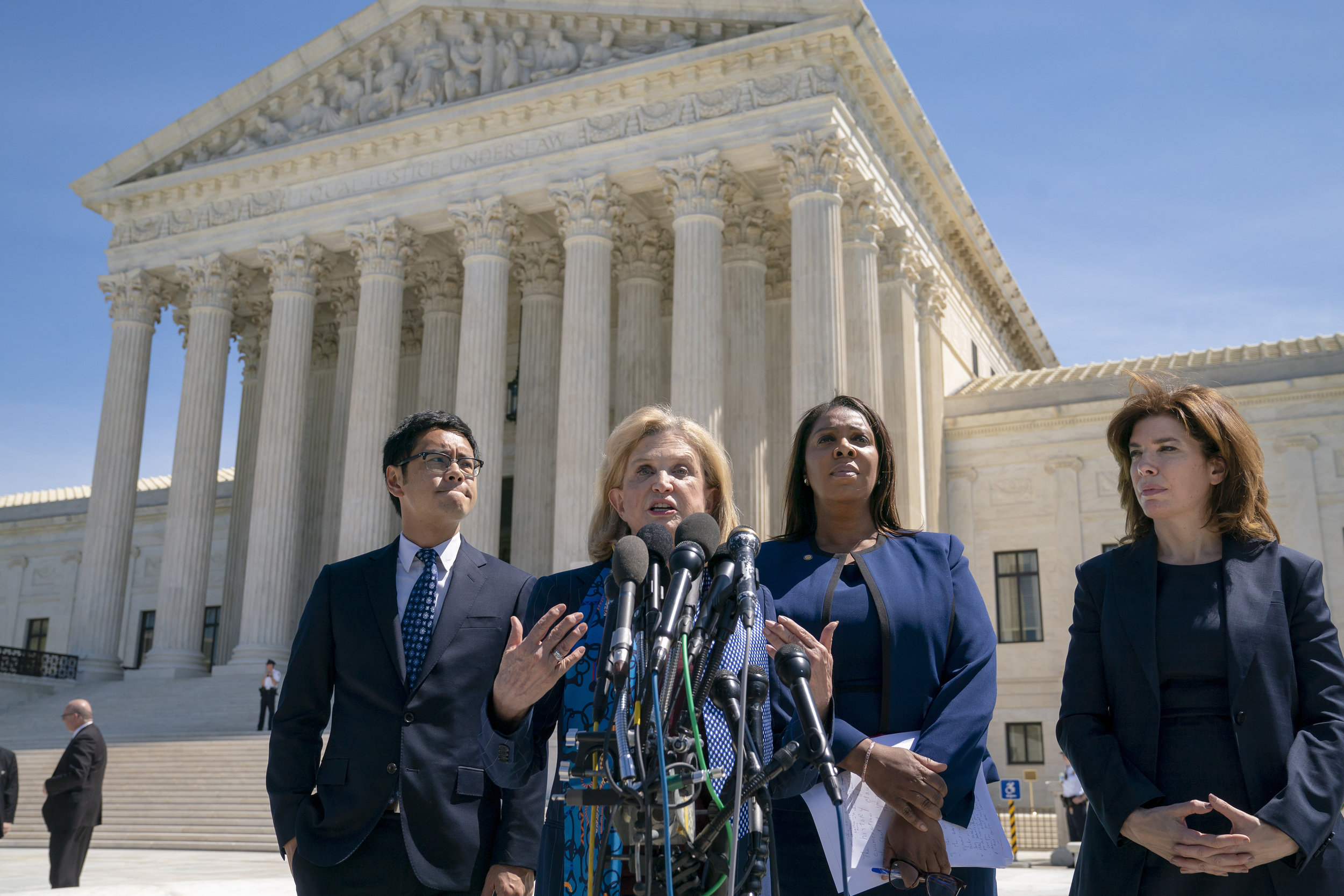 U.S. Rep. Carolyn Maloney (center) joined Dale Ho, attorney for the American Civil Liberties Union (left)m New York State Attorney General Letitia James (second from right) and New York City Census Director Julie Menin (right), speaks to reporters after the Supreme Court heard arguments over the Trump administration's plan to ask about citizenship on the 2020 census, in Washington, D.C. on Tuesday, April 23, 2019. Critics say adding the question would discourage many immigrants from being counted, leading to an inaccurate count. AP Photo/J. Scott Applewhite.