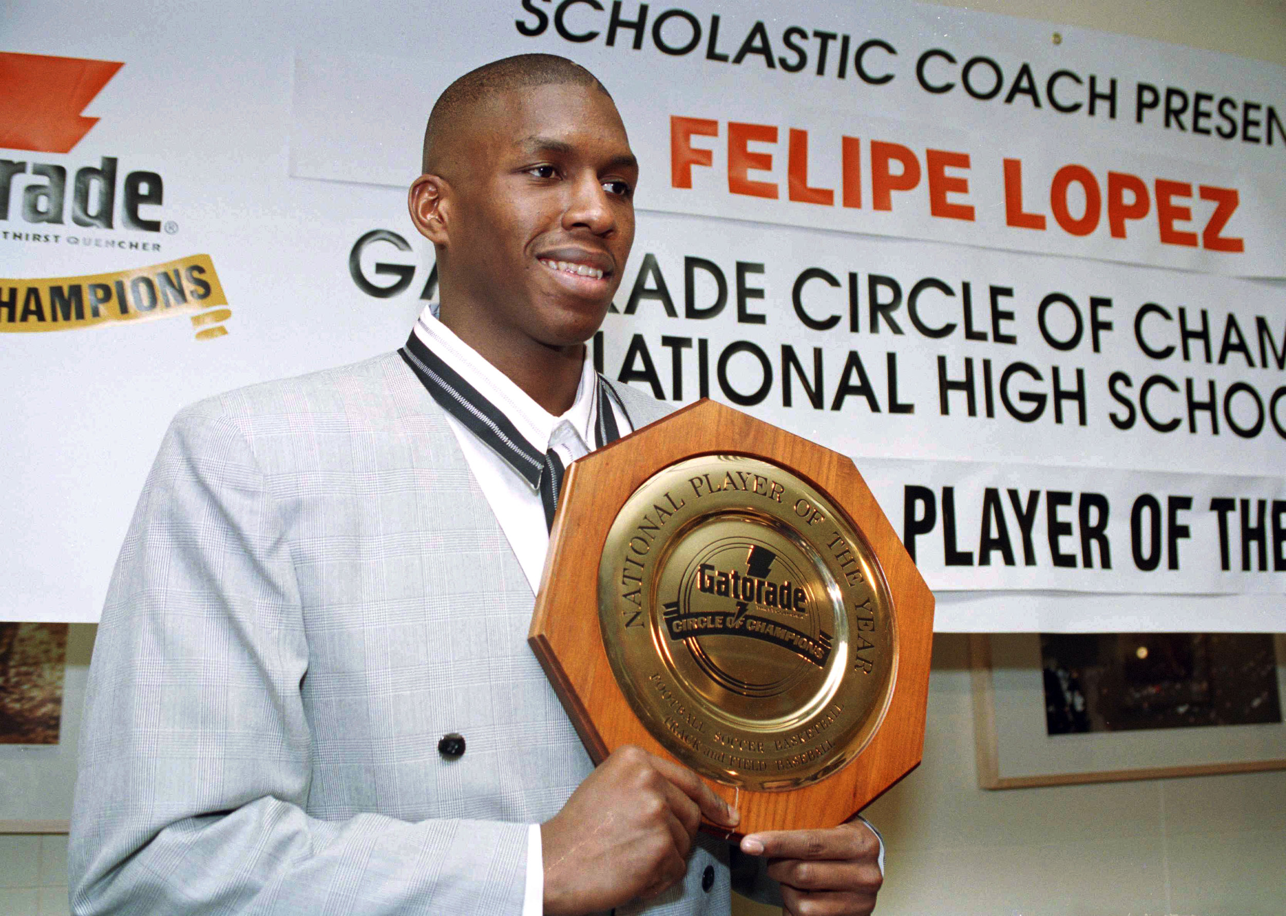 "In this March 15, 1994 file photo Felipe Lopez, a senior at Rice High School in the Bronx, is named National High School Basketball Player of the Year. Lopez, once the top-rated player in the nation in high school, went onto a four-year career at St. John's University, but could never live up to the lofty expectations in college or the NBA. His story is told in the new film ""The Dominican Dream."" (AP Photo/Marty Lederhandler, File)."