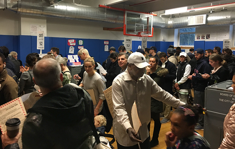 Voters stand in line to cast their ballots in 2018. Under new state law, New York residents can begin voting at designated polling places ten days before the November general election.  Eagle  file photo by Sara Bosworth.