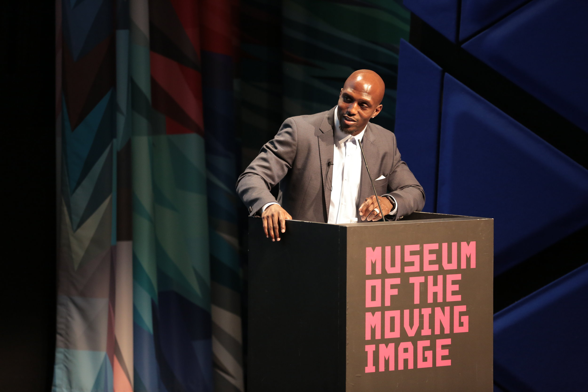 NFL player Devin McCourty moderates a DA candidates forum on May 1 at the Museum of the Moving Image. Photos courtesy of the Players Coalition.