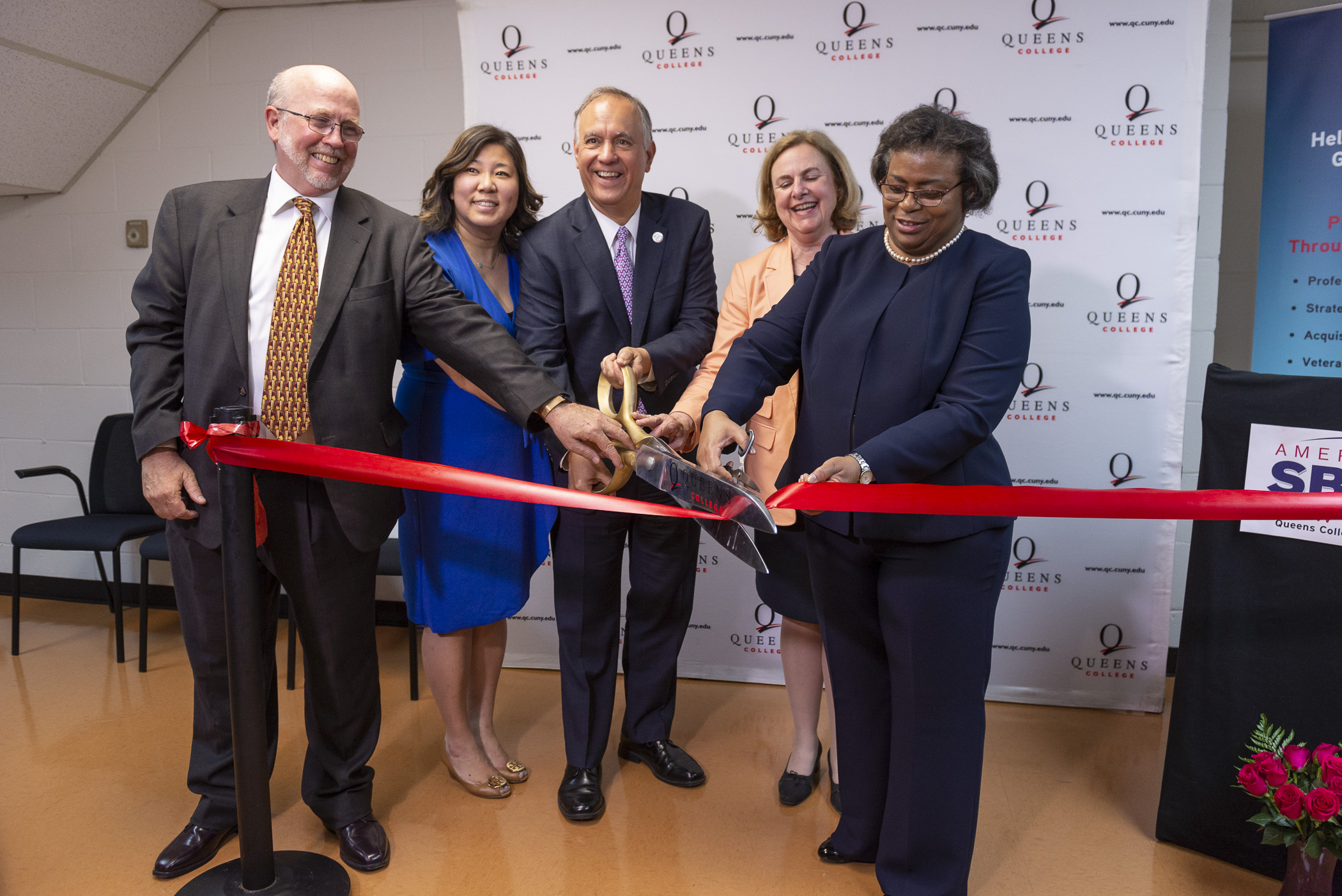 From left to right: Queens College Dean of Arts and Humanities Michael Wolfe, The Honorable Congresswoman Grace Meng (D-Queens), CUNY Chancellor and Queens College President Félix V. Matos Rodríguez; LaGuardia Community College President Gail O. Mellow, and Director of the LaGuardia Community College SBDC Rosa Figueroa celebrate SBDC's opening at Queens College. Photo by Andy Poon, courtesy of Queens College.