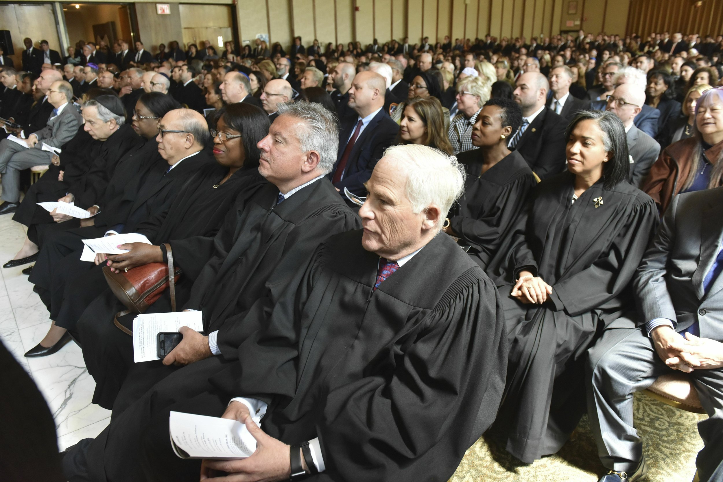 Dozens of judges attend a memorial service for former Queens District Attorney Richard A. Brown at the Reform Temple of Forest Hills on Tuesday. David Handschu/New York Law Journal via AP, Pool