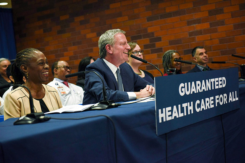 Mayor Bill de Blasio and First Lady Chirlane McCray (left) announced the plan for the NYC Care universal health insurance program in January. Photo courtesy of the Mayor's Office.
