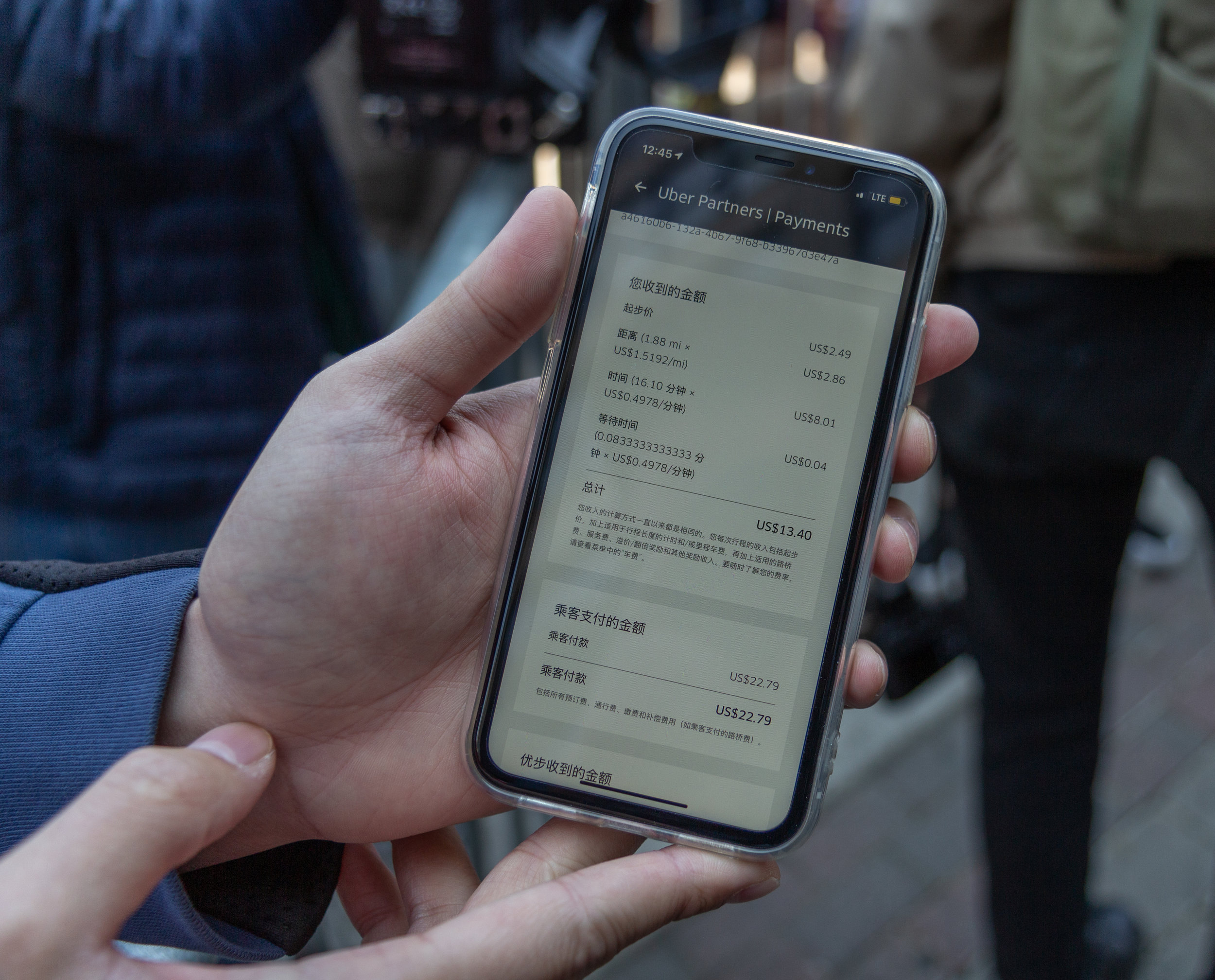 Leo Liang shows the Eagle his recent Uber payment history. On a recent 2-mile-long trip through midtown Manhattan, Liang pocketed $13.40, while the passenger paid Uber $22.79, a difference of more than 41 percent.