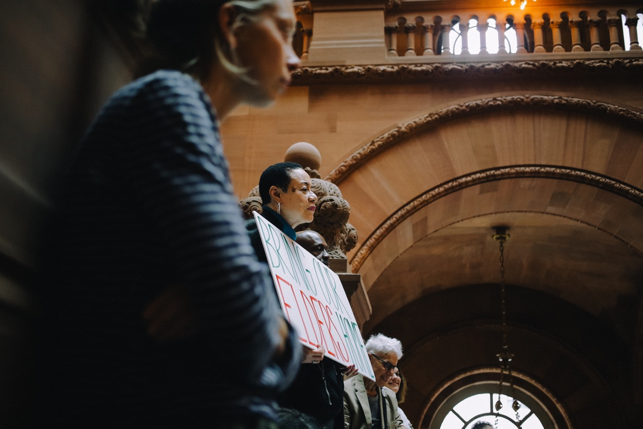 Activist Della Johnson attends an Albany rally to release older adults from prisons. Photo via RAPP
