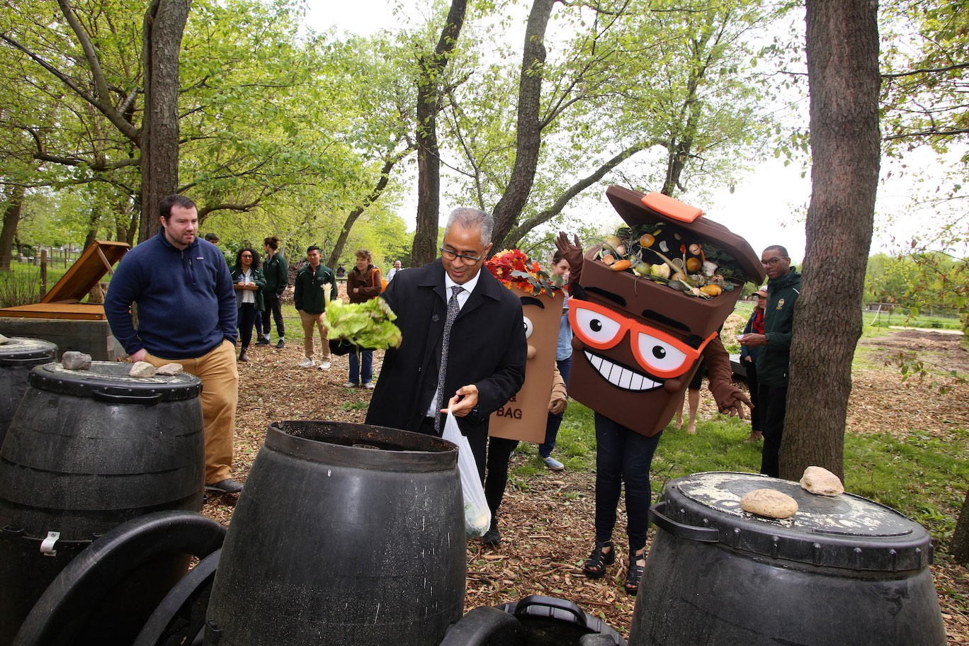 From left, Queens County Farm Executive Director Jennifer Walden Weprin, DSNY Deputy Commissioner of the Bureau of Recycling and Sustainability Bridget Anderson, Scrappy the Brown Bin, Leif the Lawn Bag, DSNY Acting Commissioner Steven Costas, and DSNY Chief and Director of Cleaning and Collection Edward Grayson.
