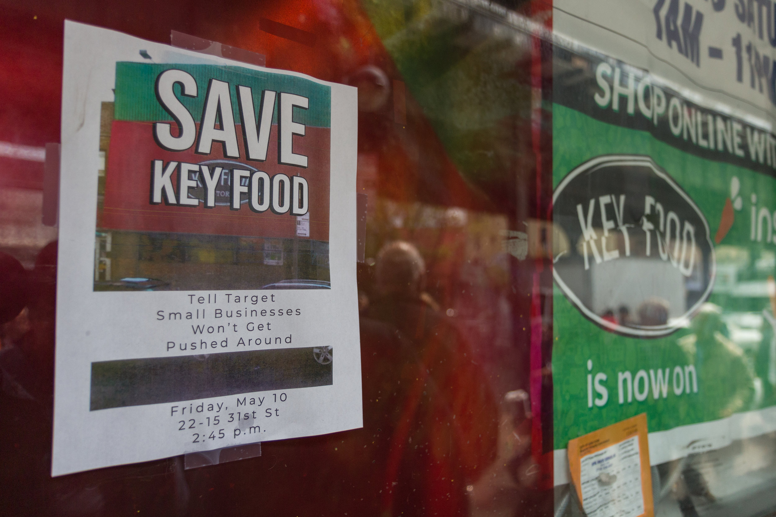 A poster advertises the rally to save the Astoria Key Food.