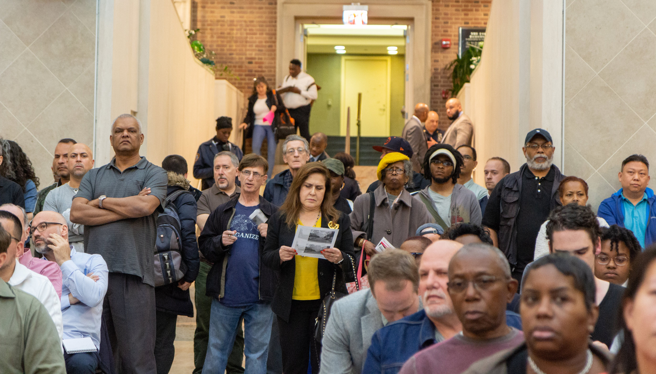 A standing-room-only crowd attended a public hearing on the city's plan to build a new jail in Kew Gardens last month.  Eagle  photo by Jonathan Sperling